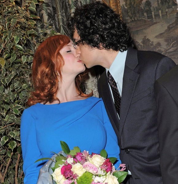 Christina Hendricks kisses