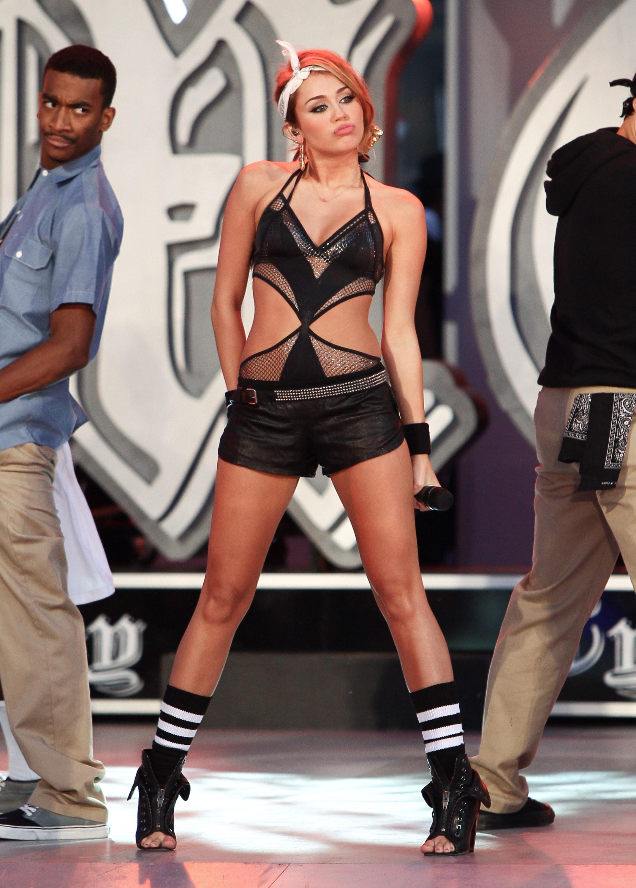 Miley Cyrus bodysuit black shorts bandana
