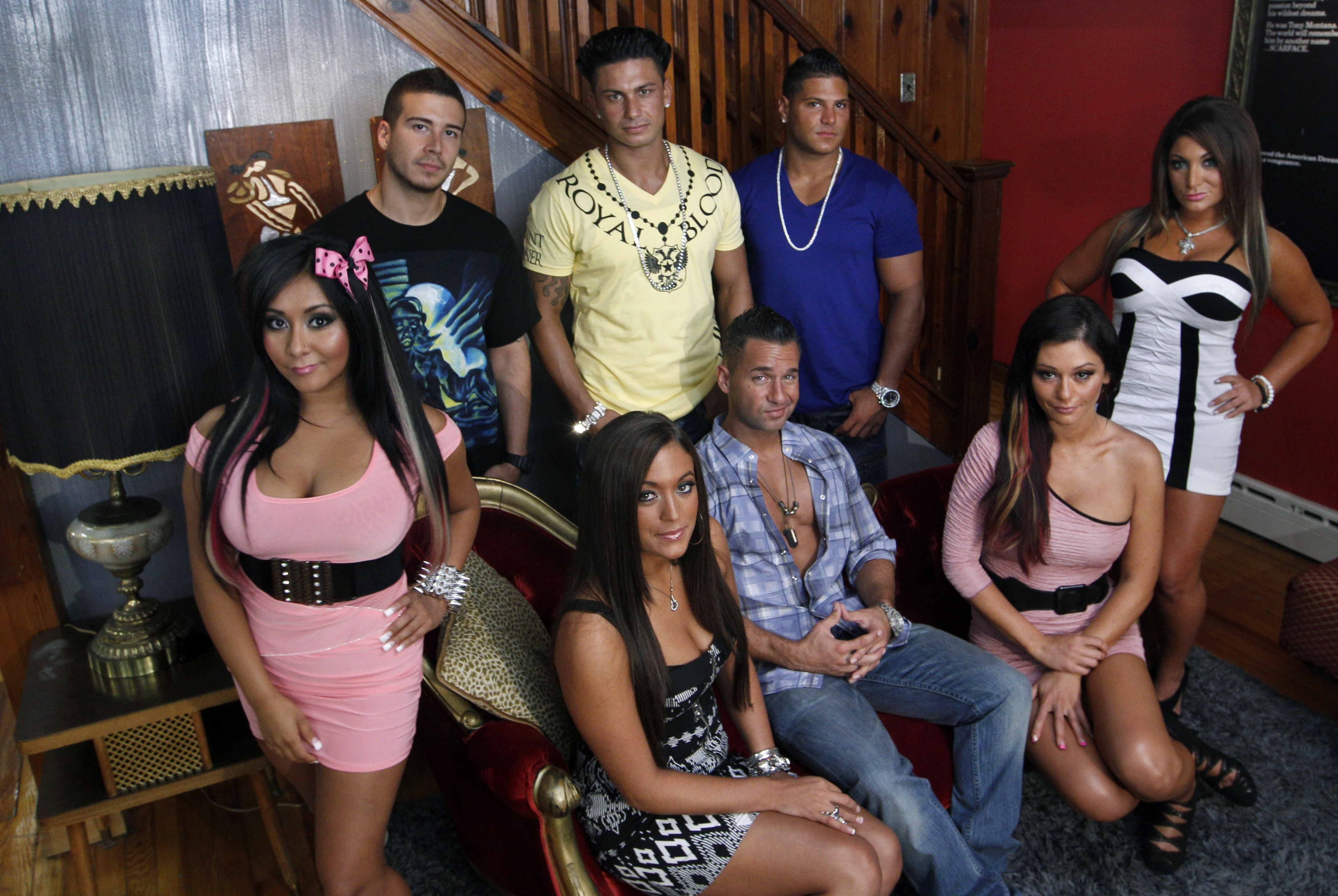 """The cast members of MTV's """"Jersey Shore"""" pose  at their television home Aug. 4, 2011, in Seaside Heights, N.J."""
