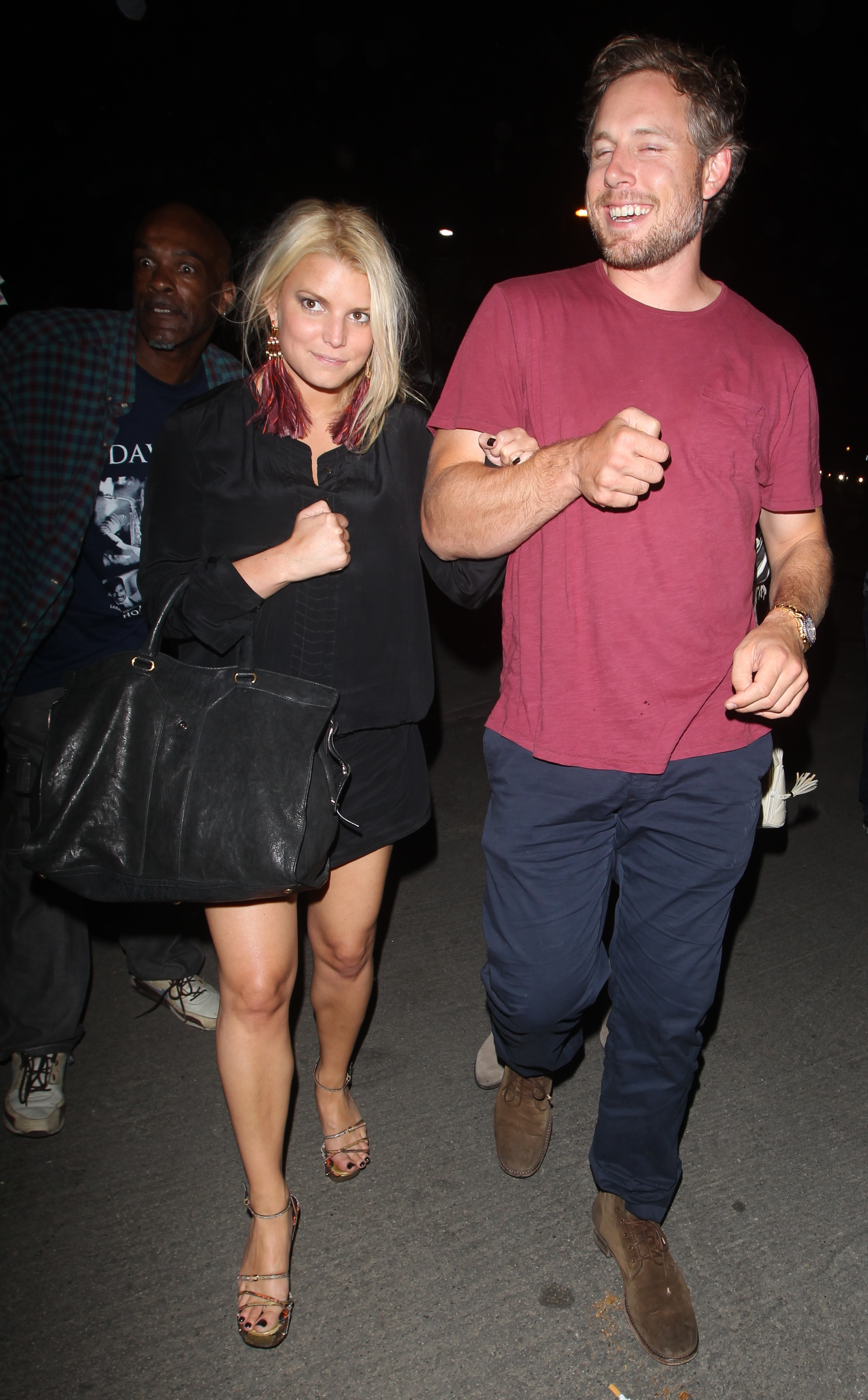 eric johnson holds hands with jessica simpson