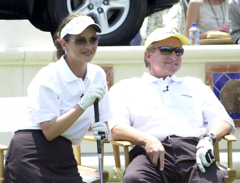 Catherine Zeta Jones and Michael Douglas golf