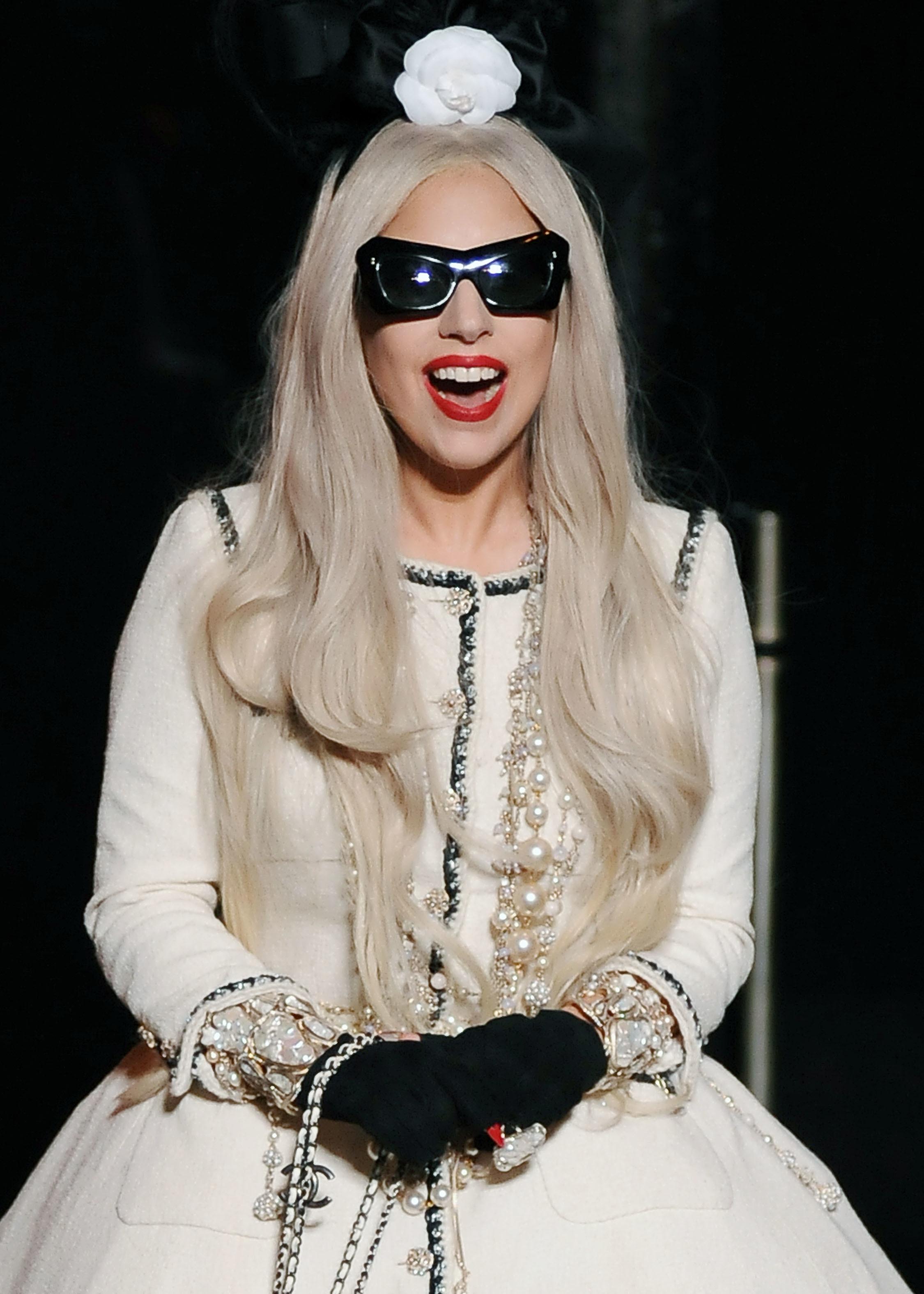 Lady Gaga rider white coat turban