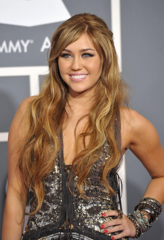 Miley Cyrus short platinum hair long hair