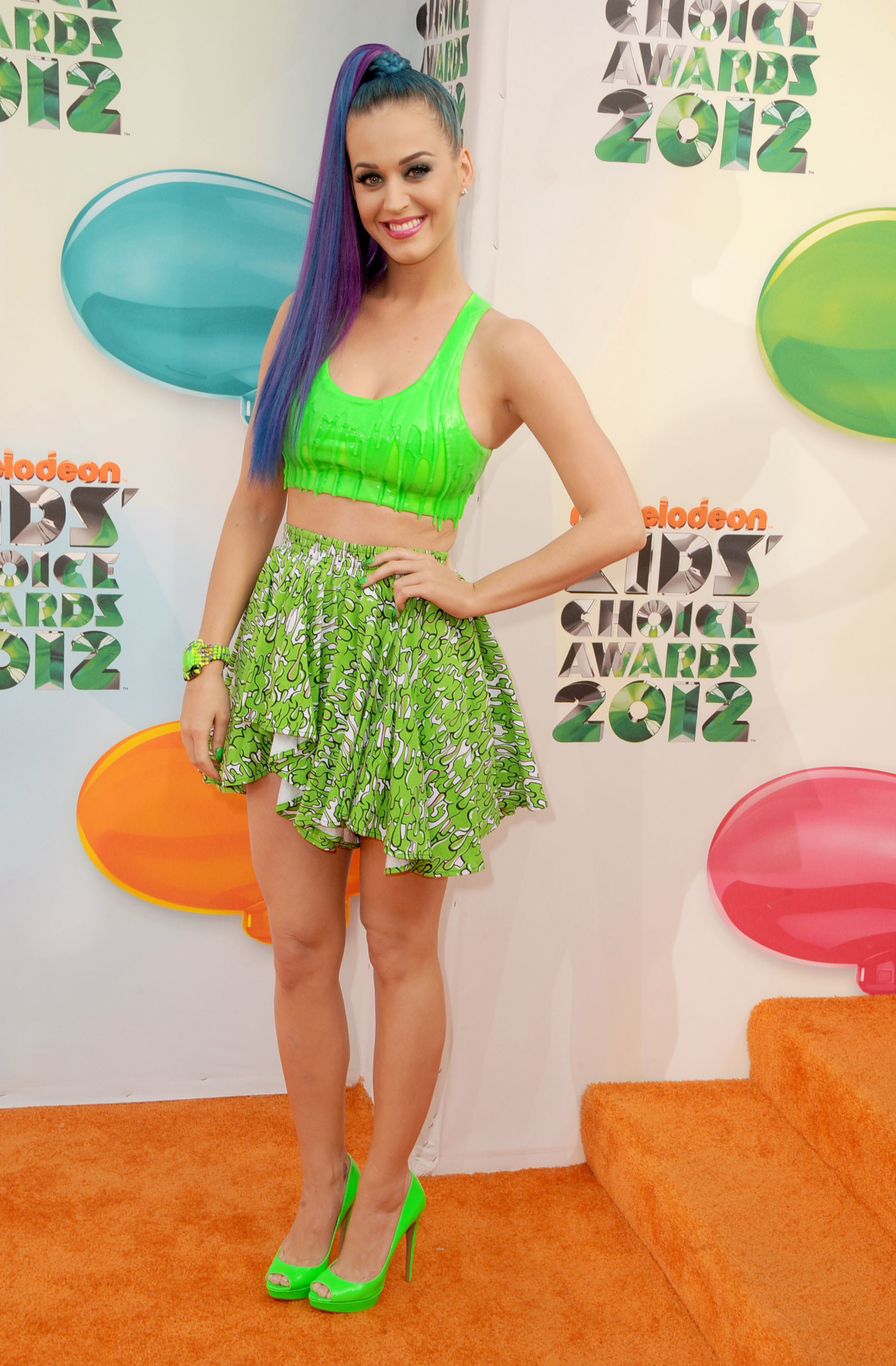 Katy Perry neon top and skirt side ponytail rider