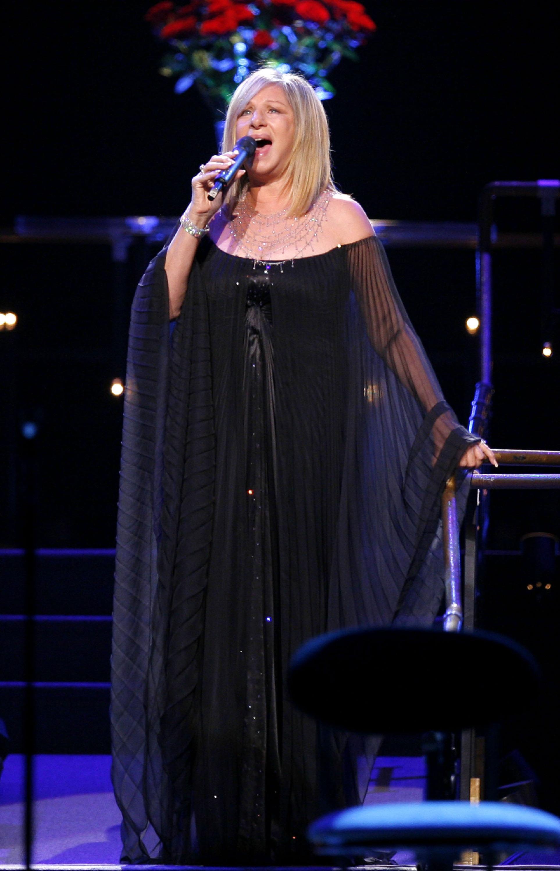 Barbara Streisand tour rider black dress
