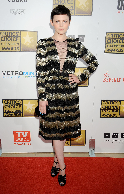 Ginnifer Goodwin black and gold striped dress