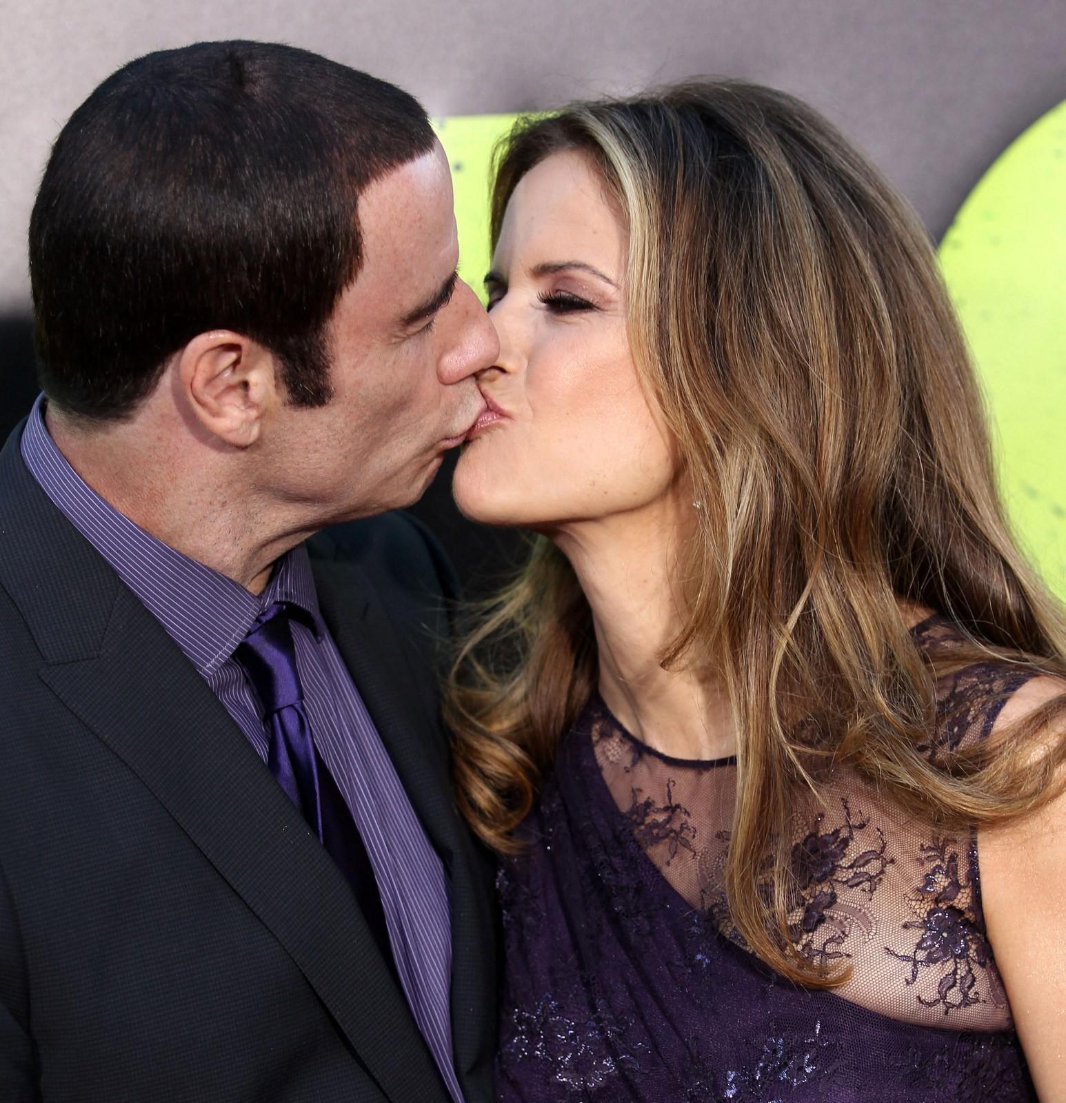 John Travolta Kelly Preston kiss Savages premiere