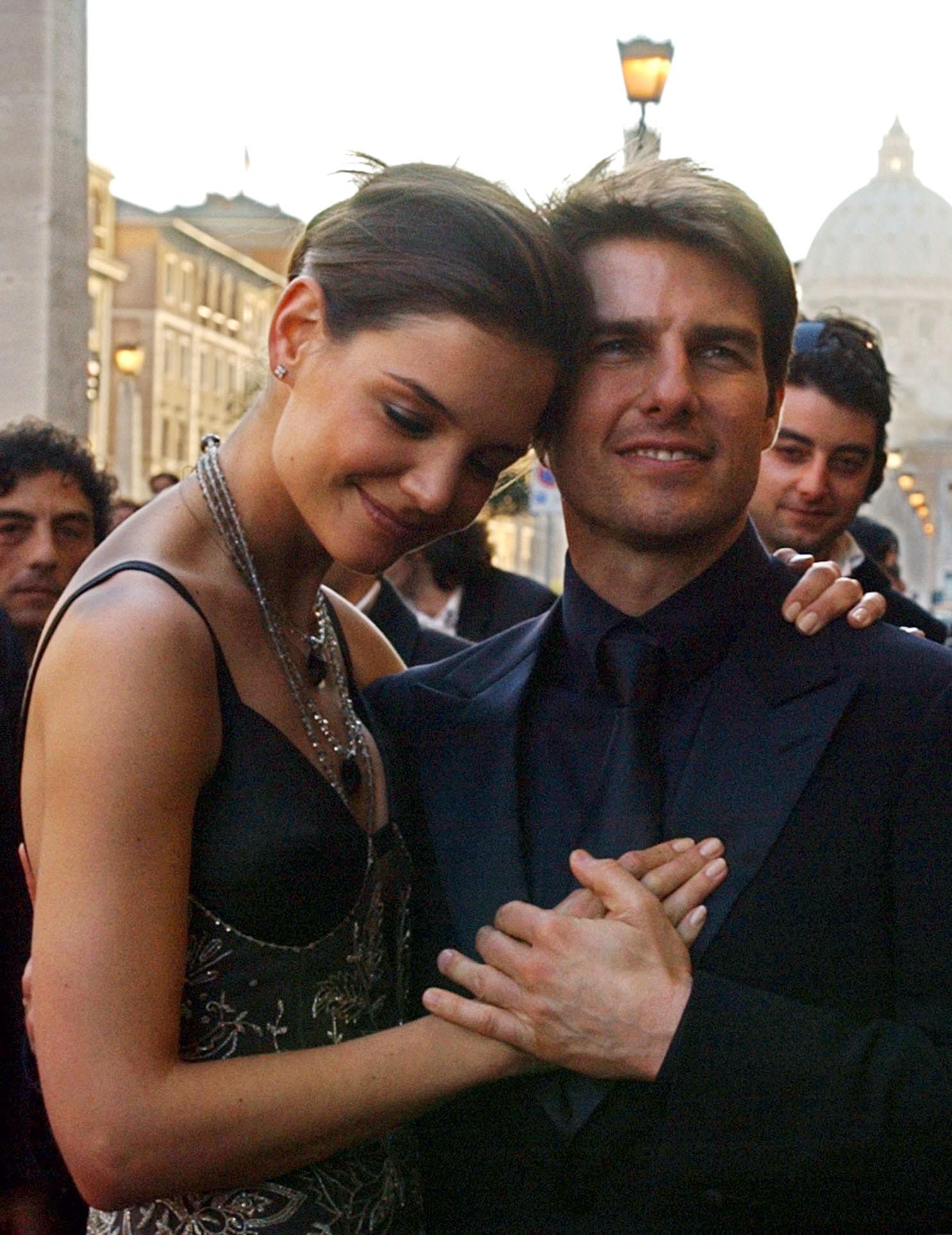 Katie Holmes Tom Cruise caress navy