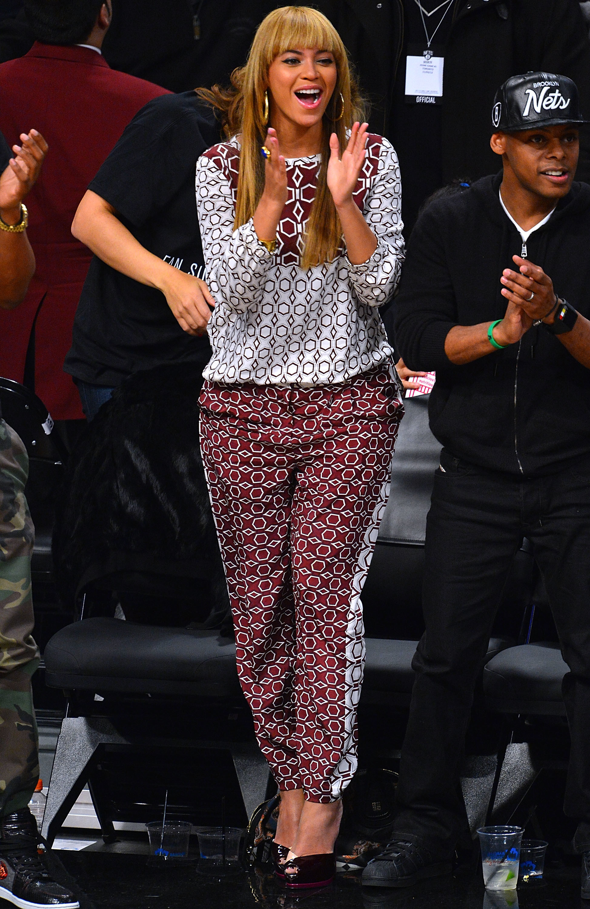 Beyonce Jay Z courtside red jumpsuit