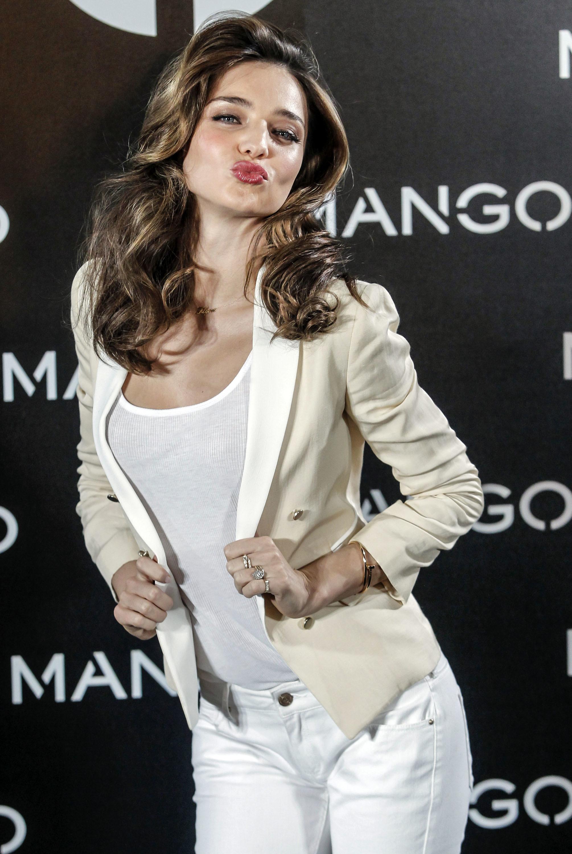 Miranda kerr blows a kiss