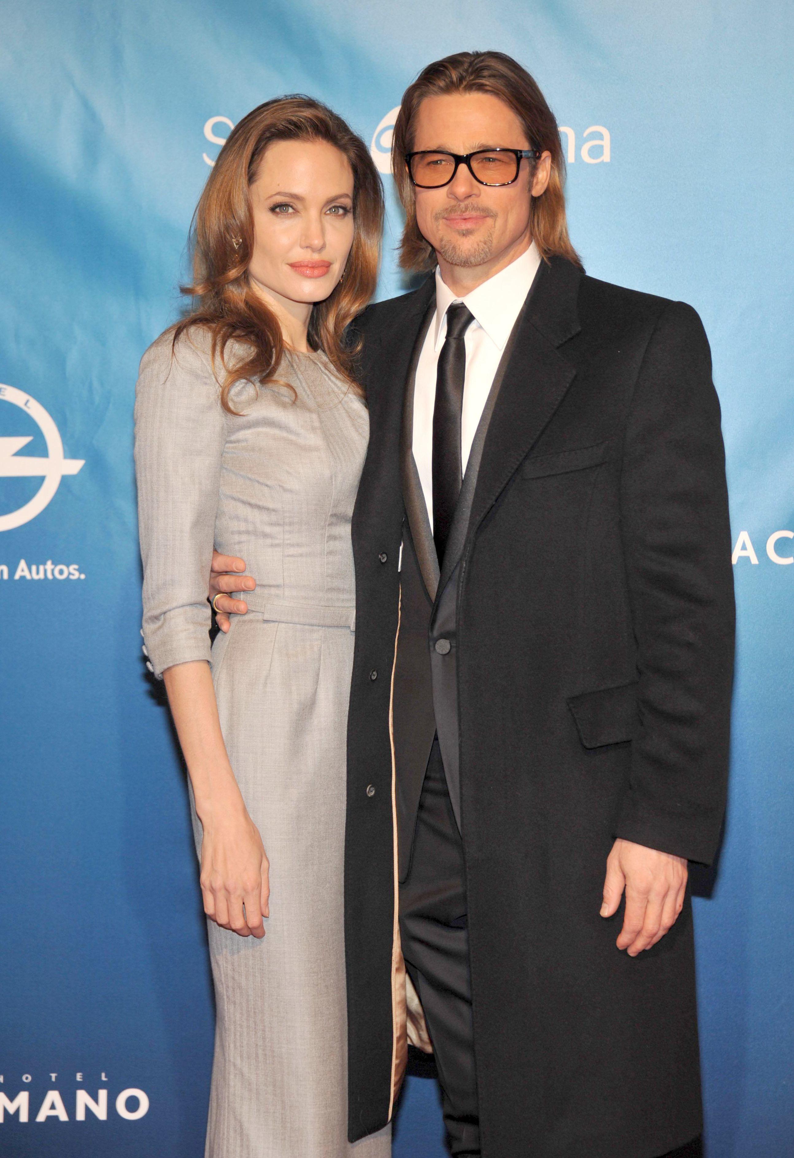 Angelina Jolie silver dress Brad Pitt tuxedo