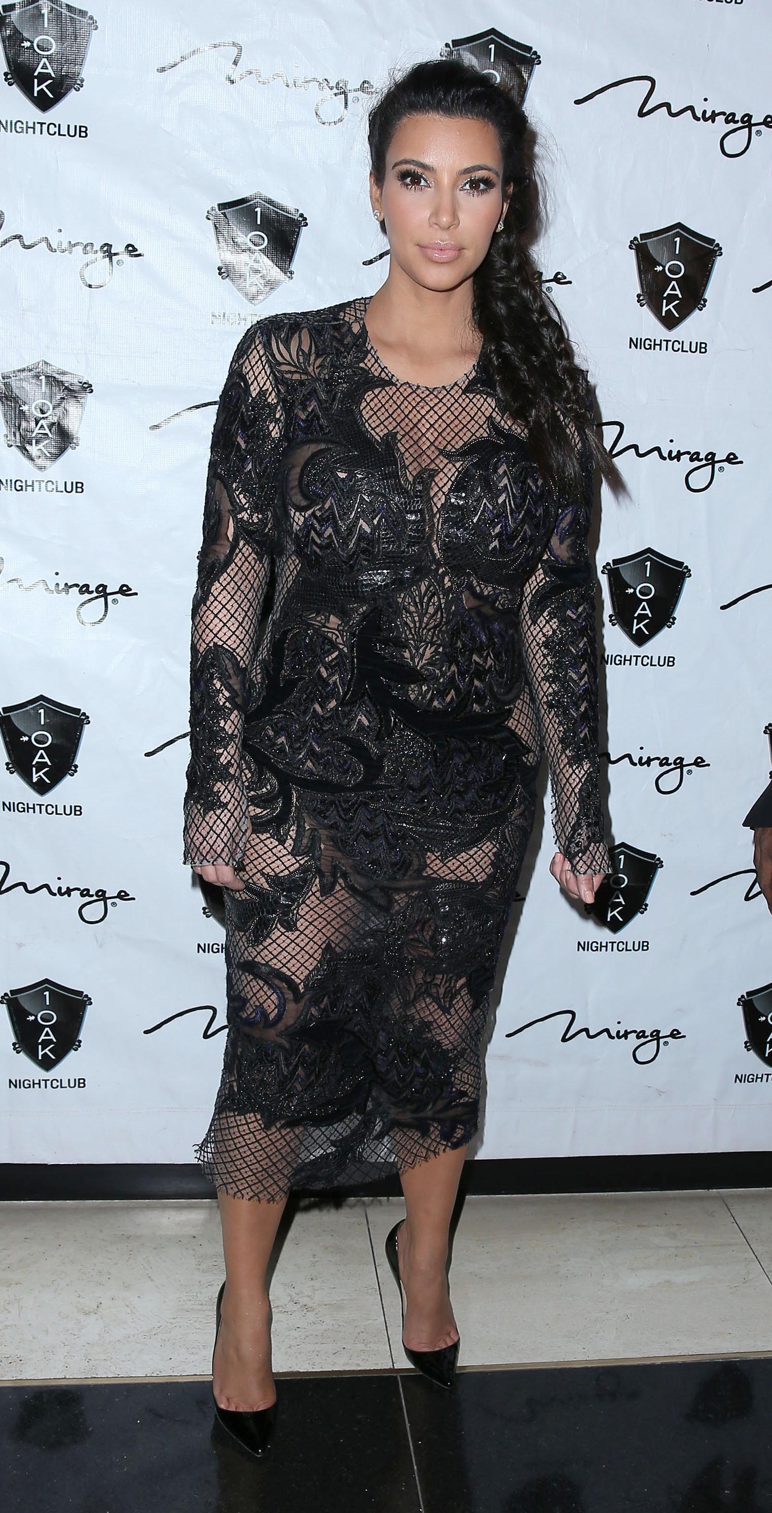 Kim Kardashian scantily clad