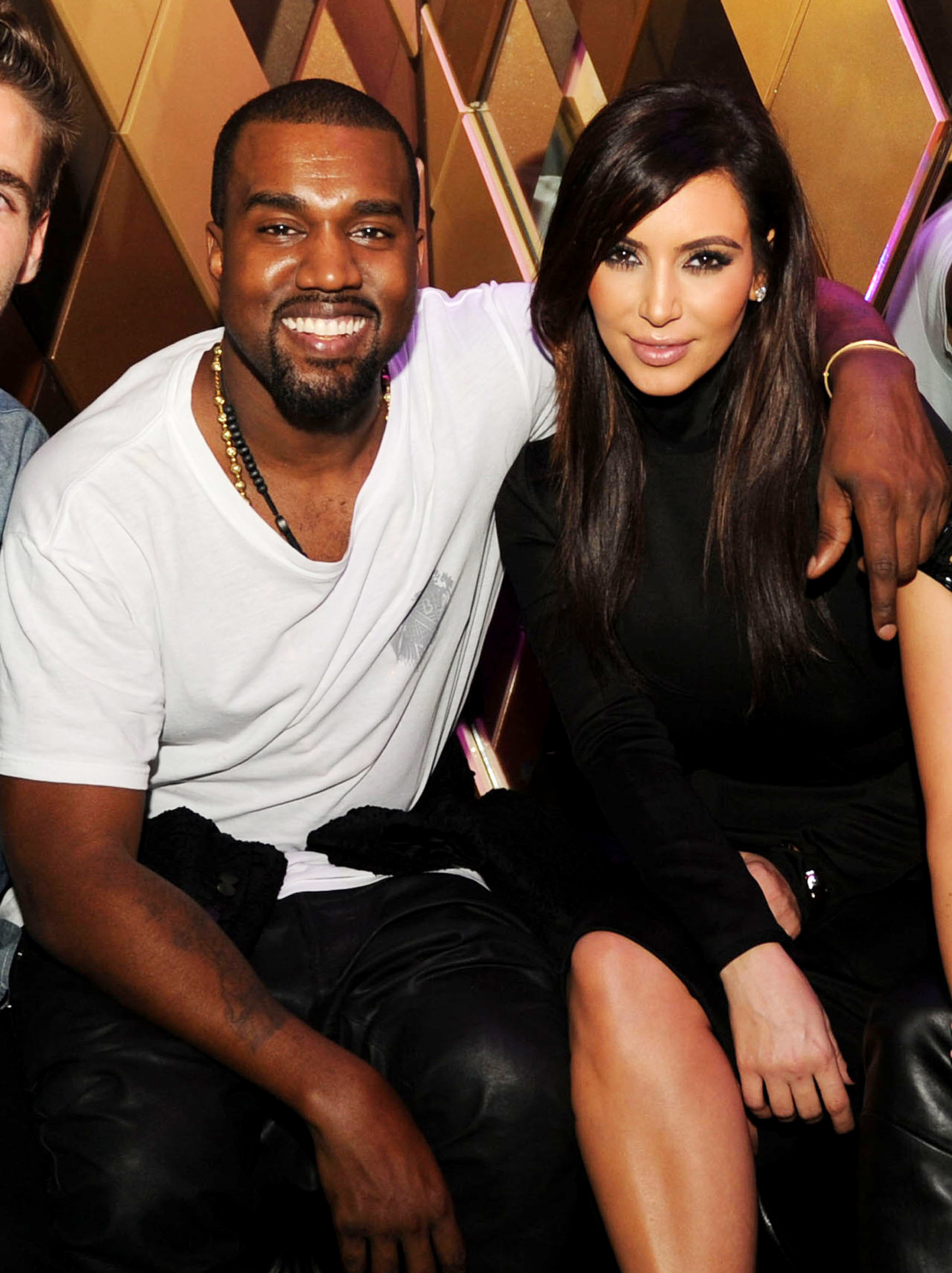 Kanye West white t shirt Kim kardashian black turtlenesck