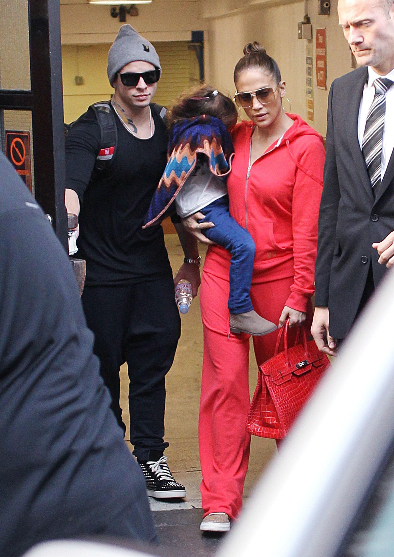 Jennifer lopez red sweat suit red alligator birkin
