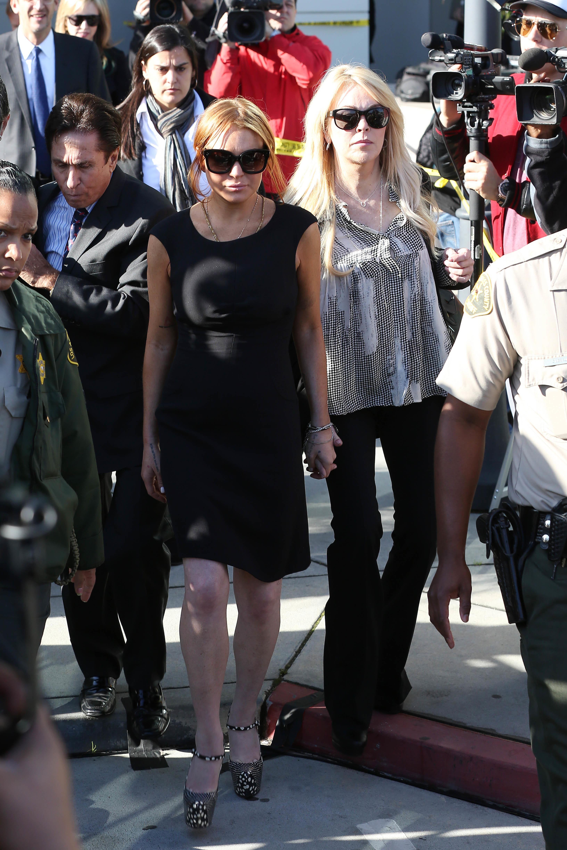 Lindsay Lohan black dress christian louboutin pumps