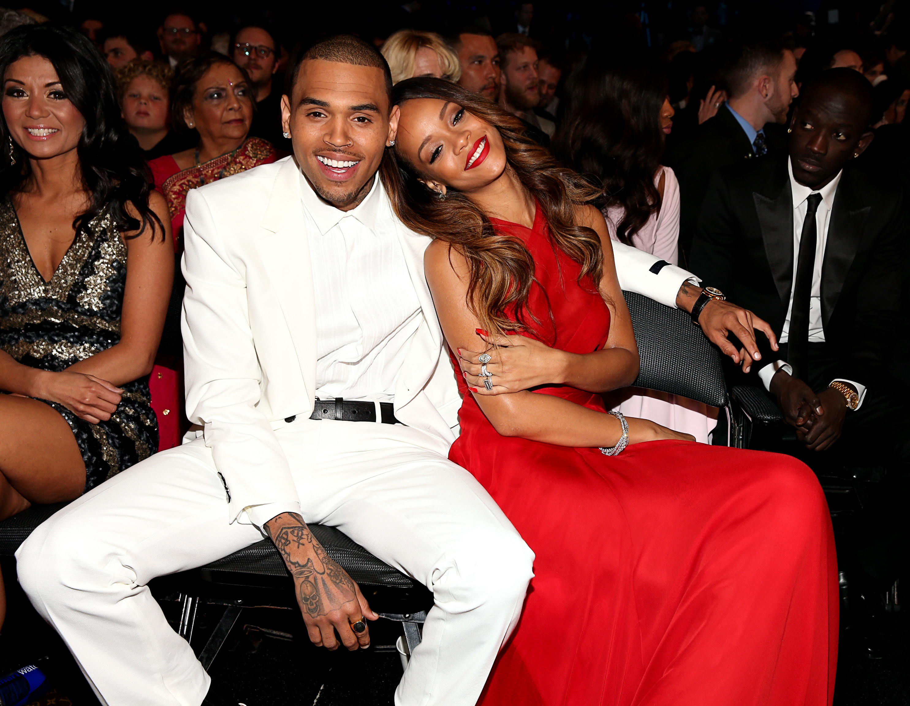 Chris Brown white suit Rihanna red dress
