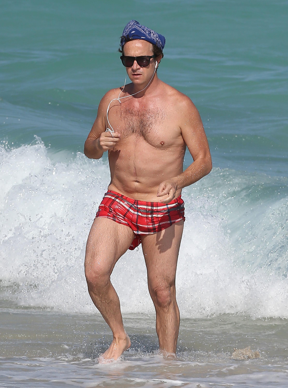 Pauly Shore shirtless beach