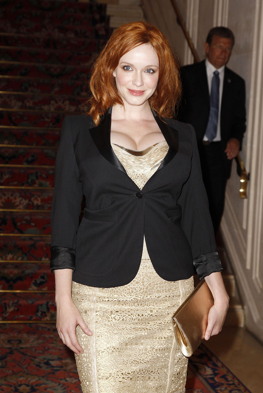 Christina Hendricks gold dress black blazer versace