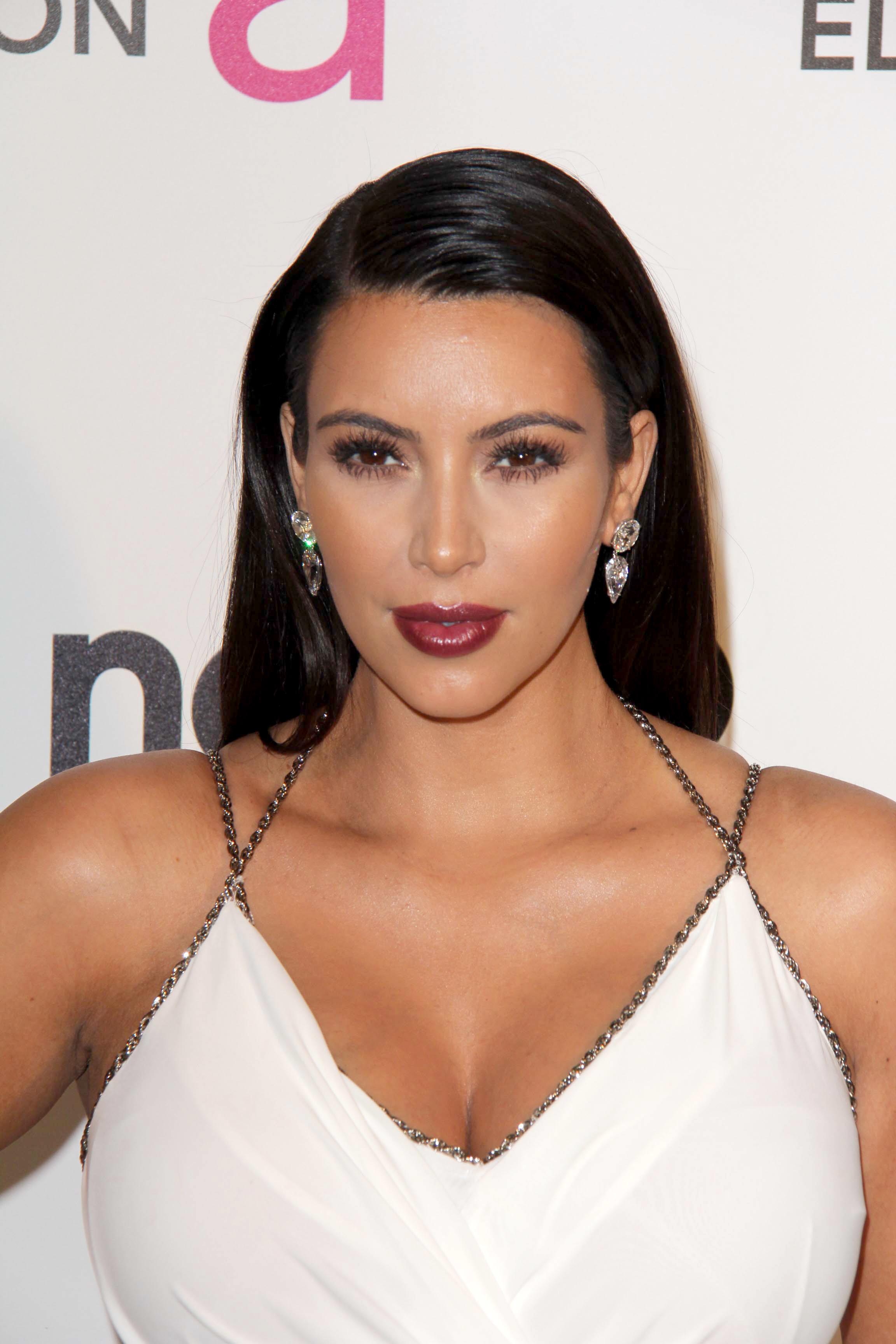 Kim Kardashian side part hair