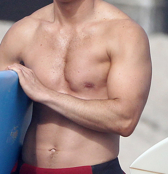 Mark Paul Gosselaar surfboard wetsuit beach shirtless