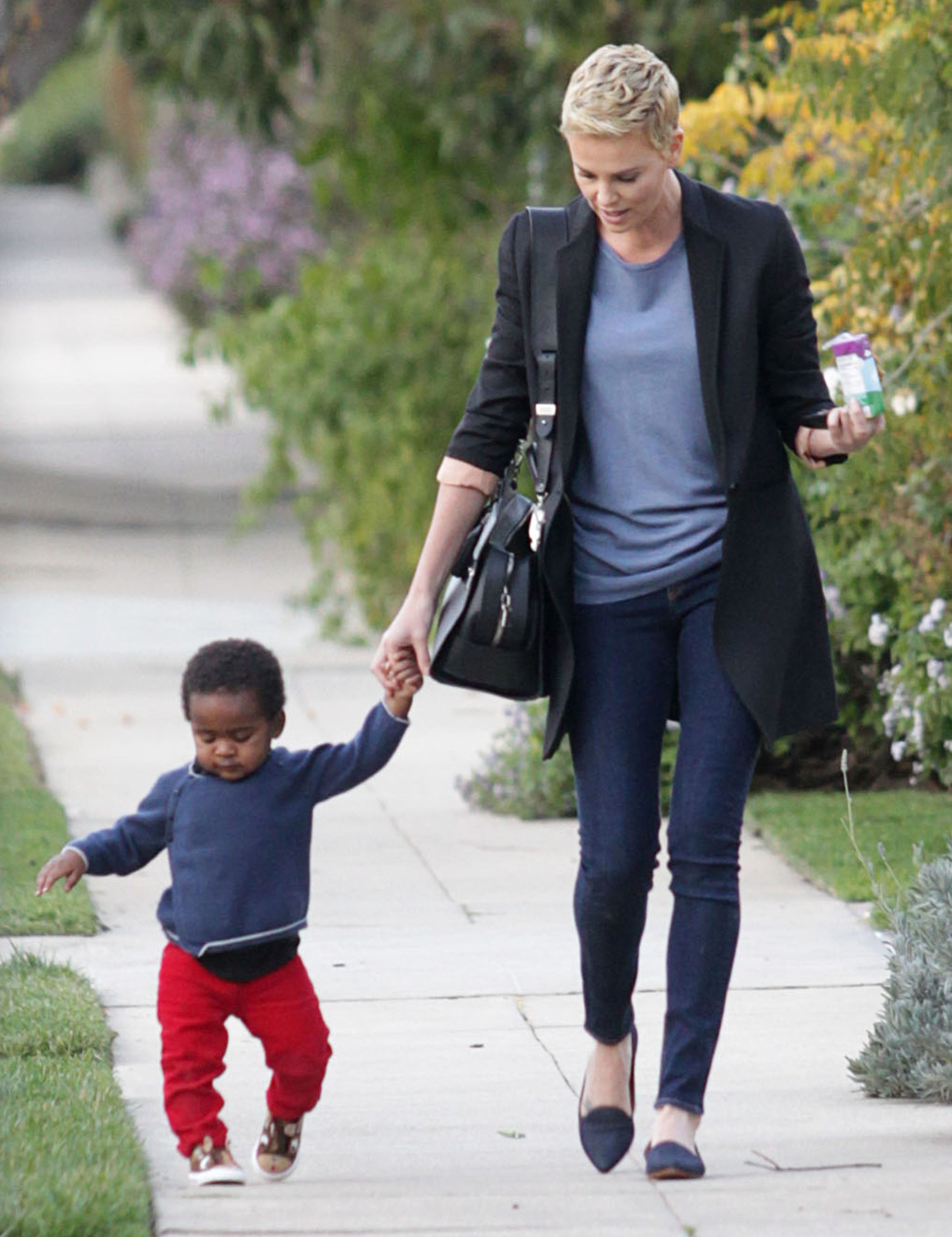 charlize theron adopt son jackson tears up talking about being a mom