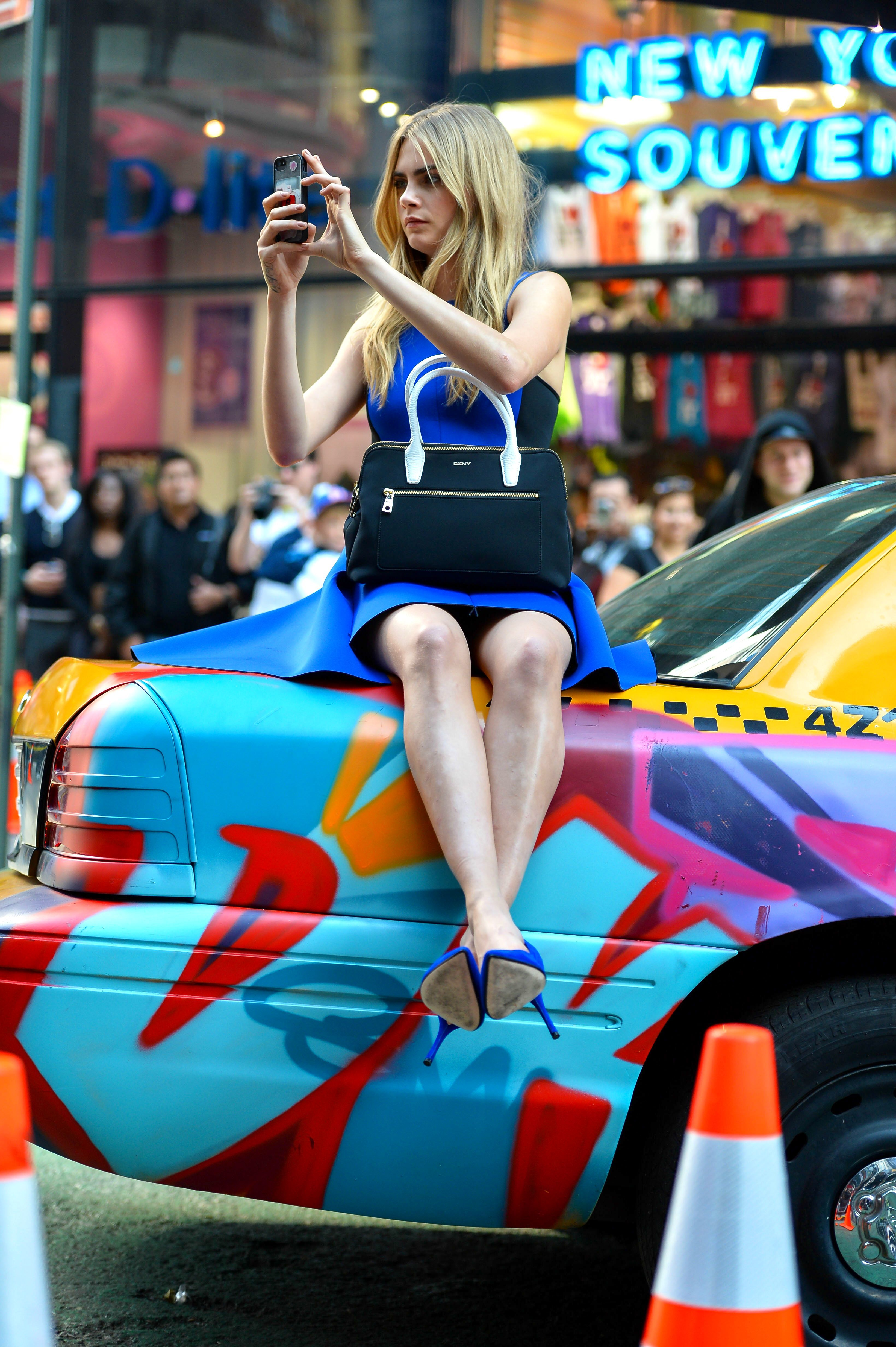 cara delevingne times square dkny funny