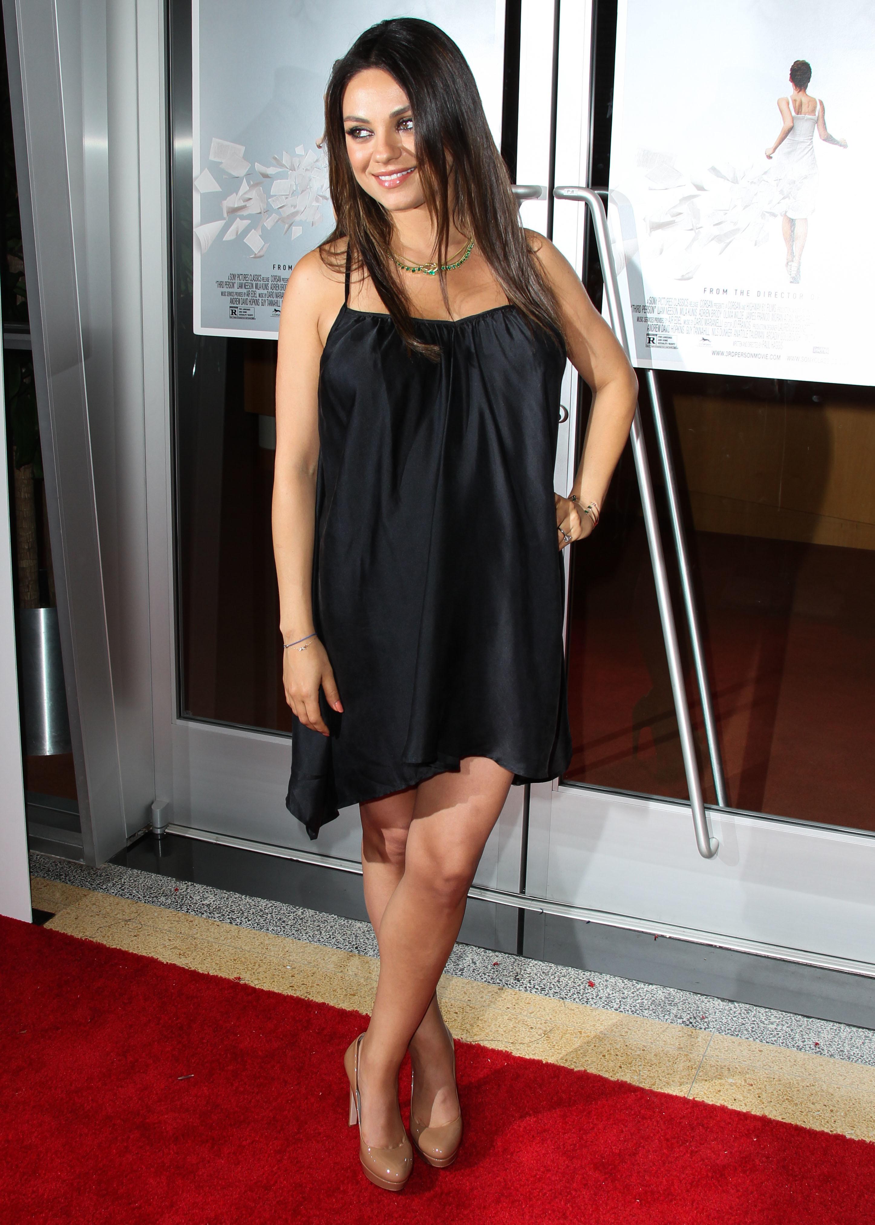 Mila Kunis red carpet bump