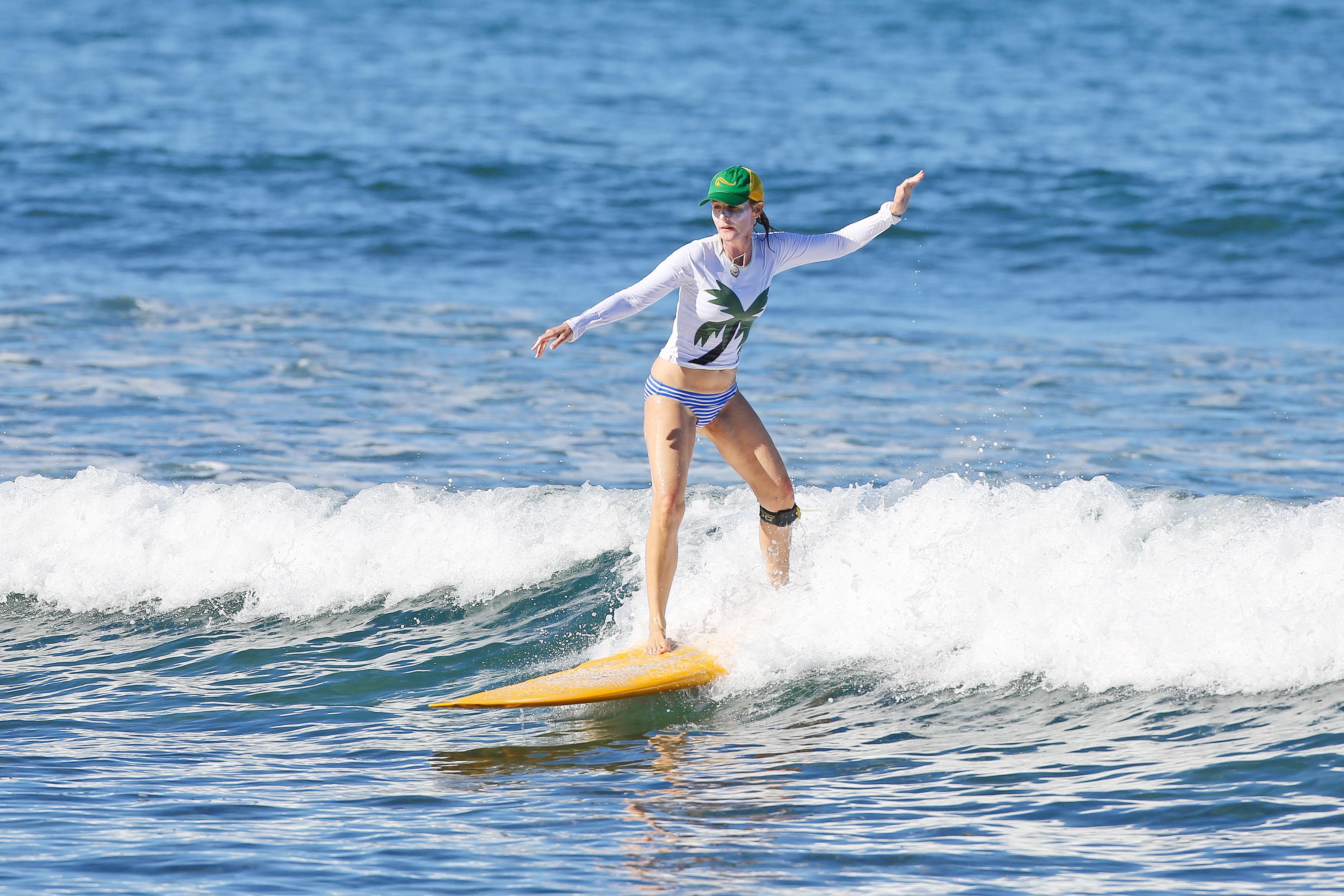Helen Hunt surfing