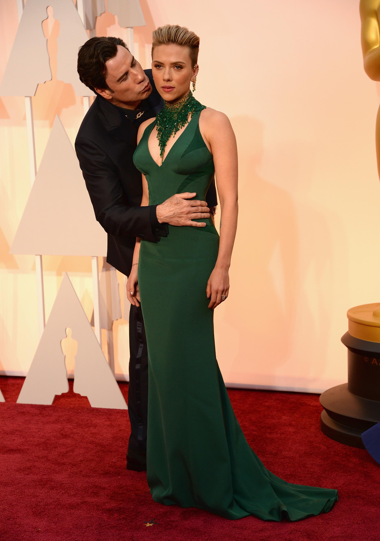 John Travolta creeps on Scarlett Johansson at the Oscars