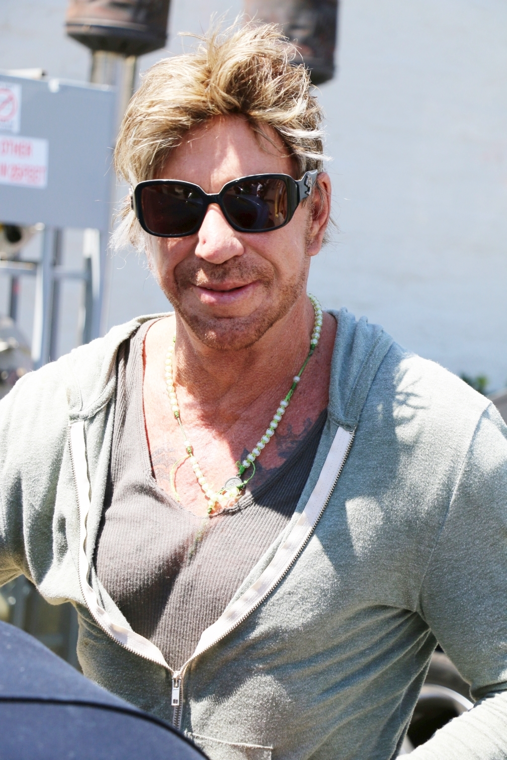Mickey Rourke's hairstyle is a sight to be seen ...