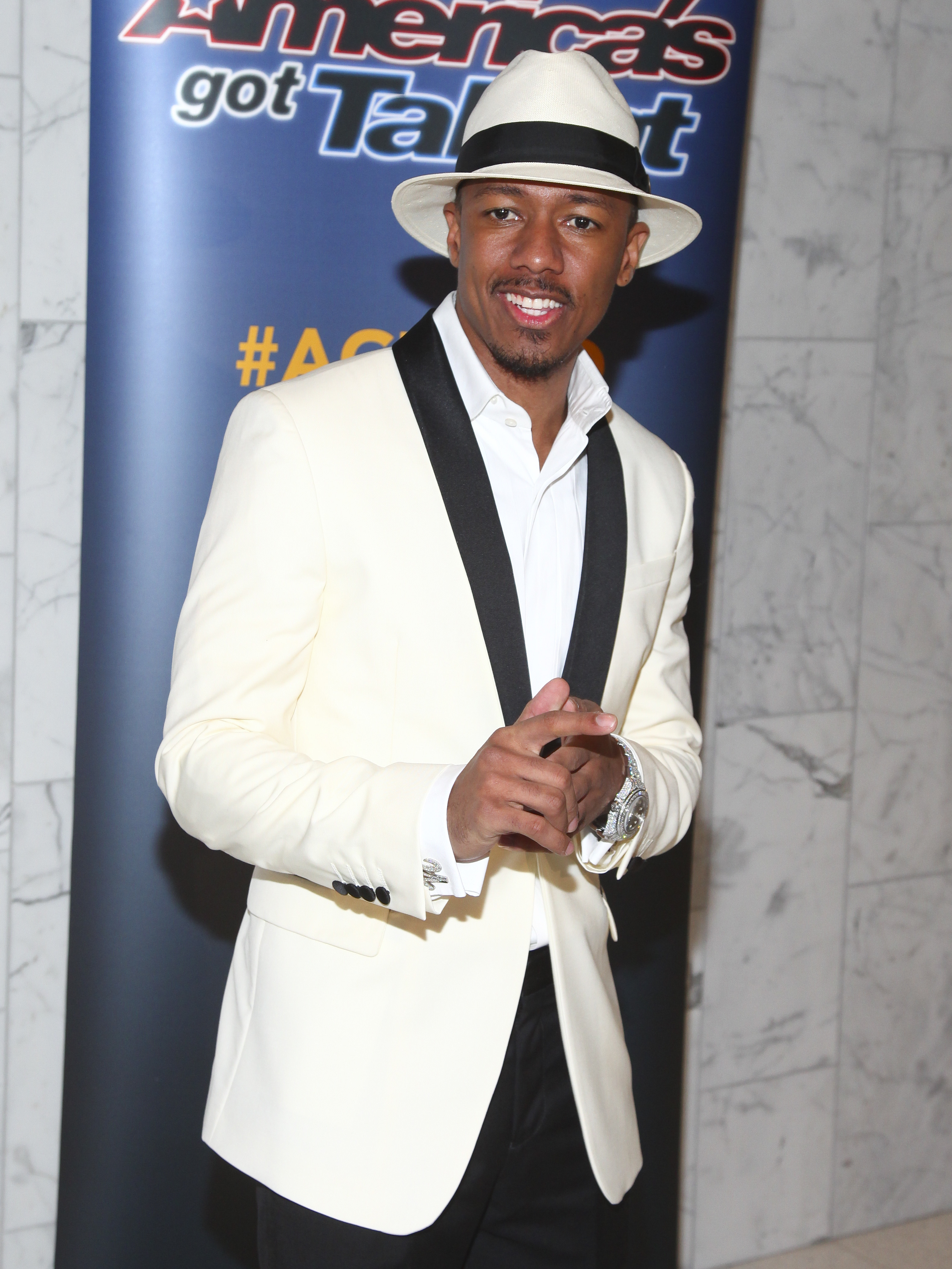 "Nick Cannon raps about Mariah Carey on ""Divorce Papers"" track,"