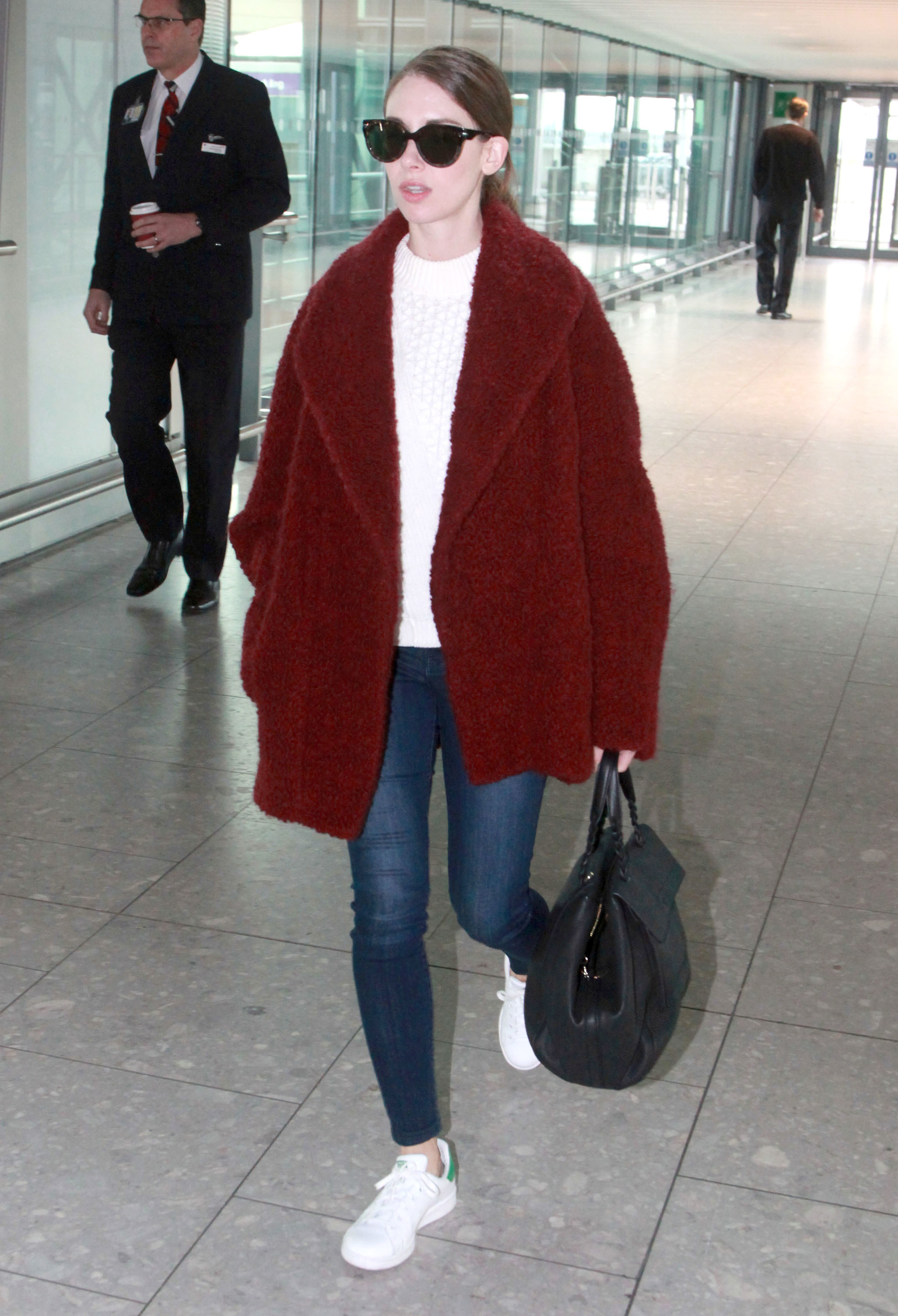Alison Brie departs on a flight to New York from Heathrow Airport in London on Feb. 10, 2016.