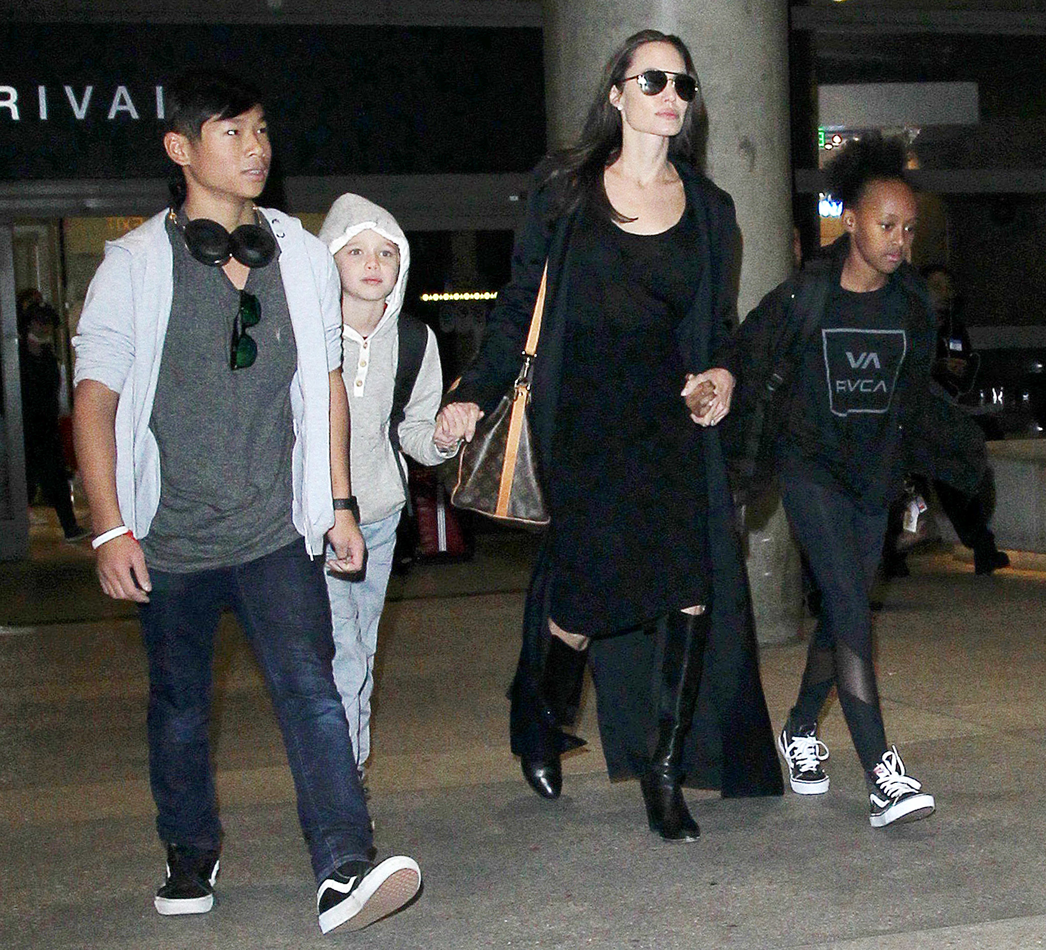 Angelina Jolie and her daughters help Cambodian family go to school