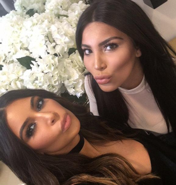 Kim Kardashian bumps into her fashion blogger twin