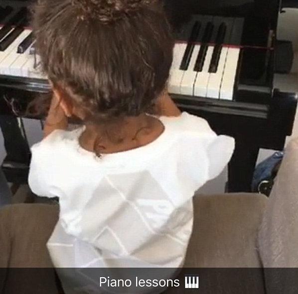 Kanye West's mini me North starts piano lessons,