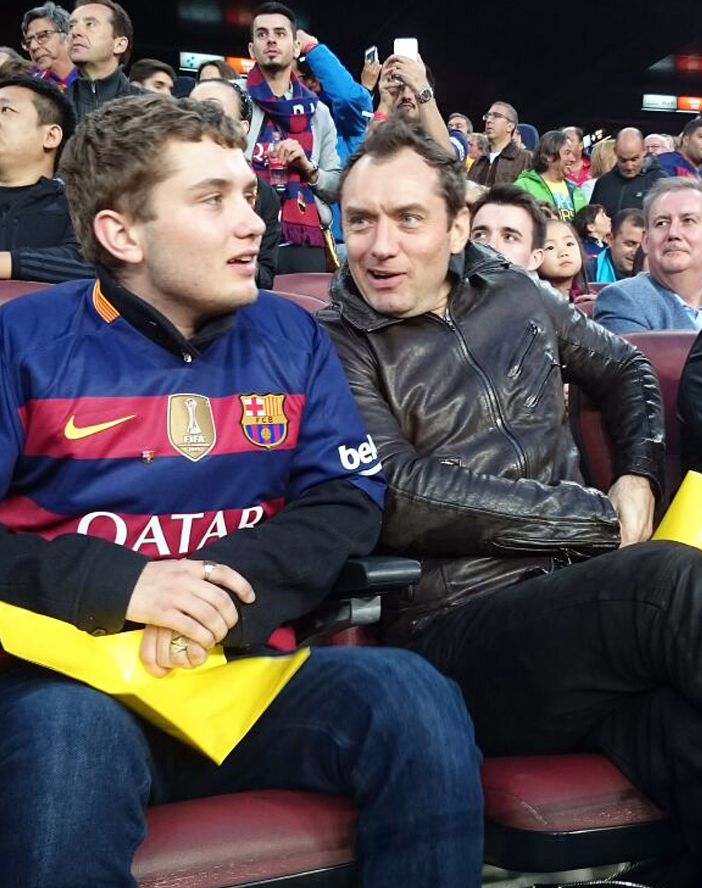 Jude Law catches a soccer game with his lookalike son
