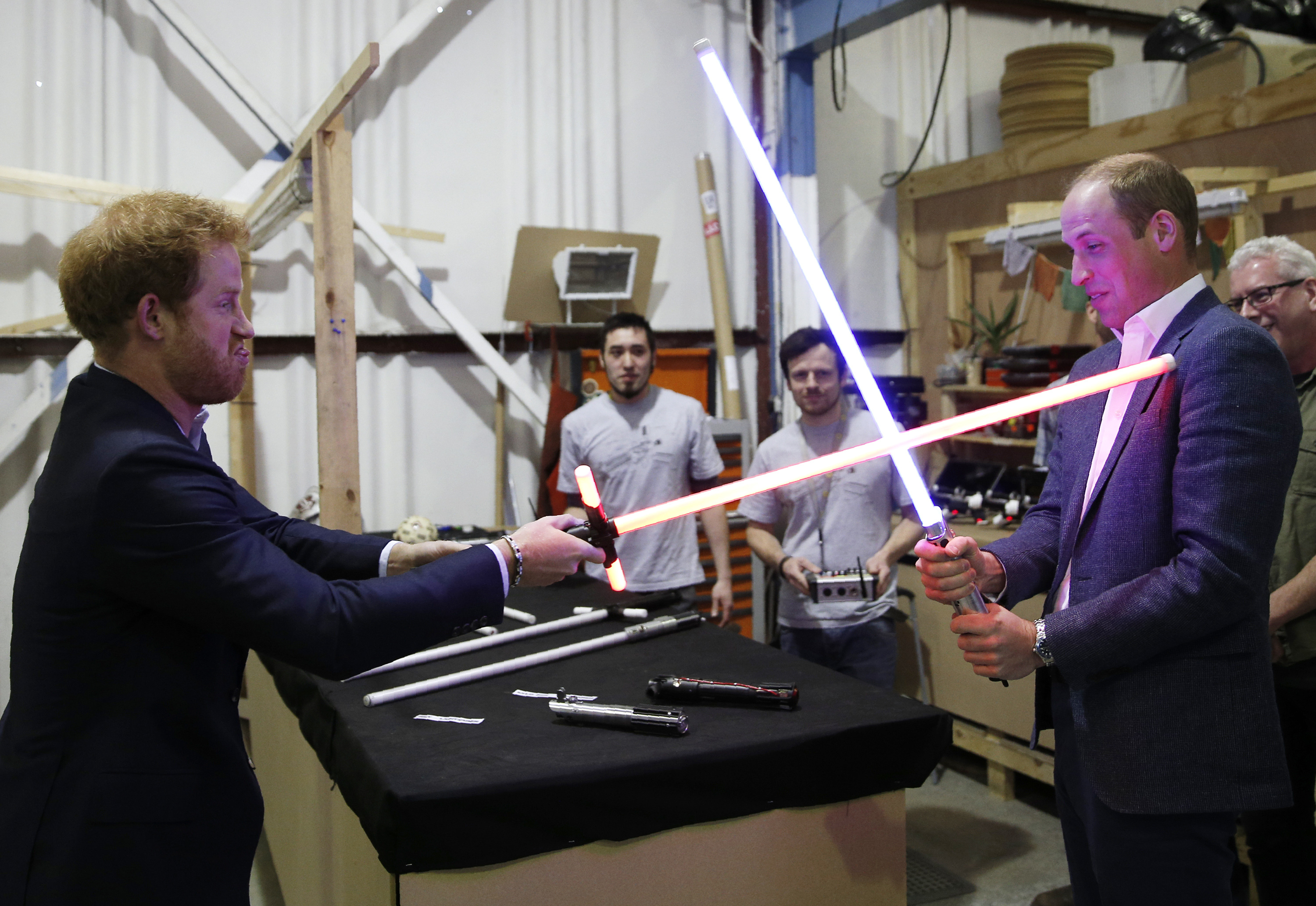 Prince Harry has a lightsaber showdown with Prince William