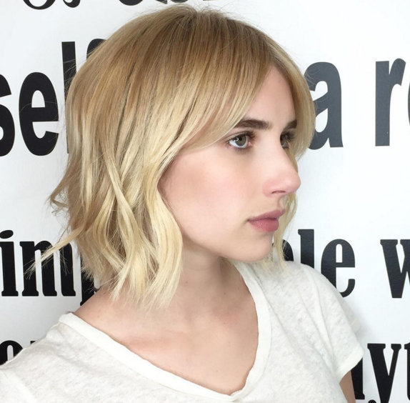 Emma Roberts' hair goes from long and red to short and blonde