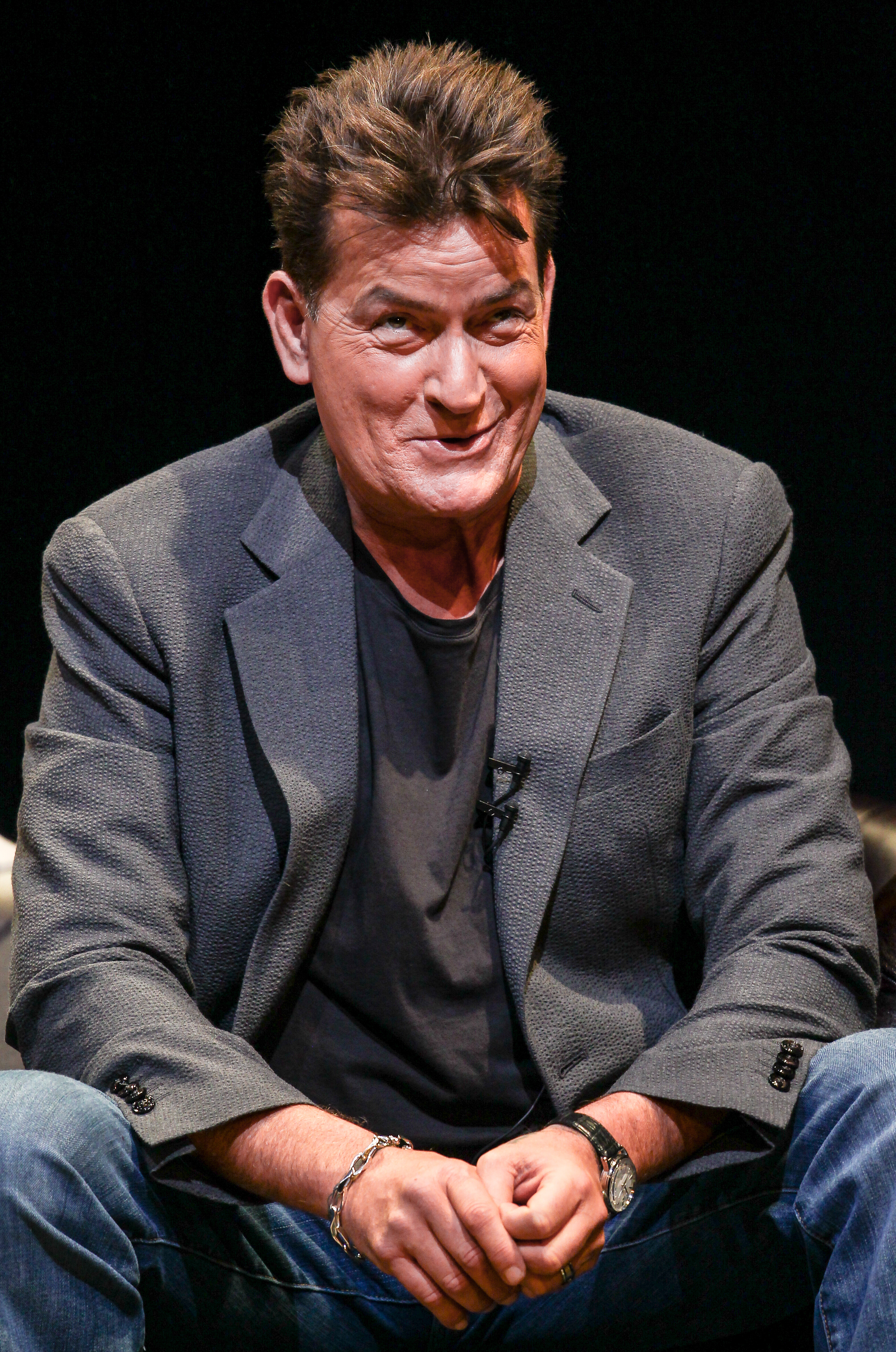 Charlie Sheen shows off his ladies man side