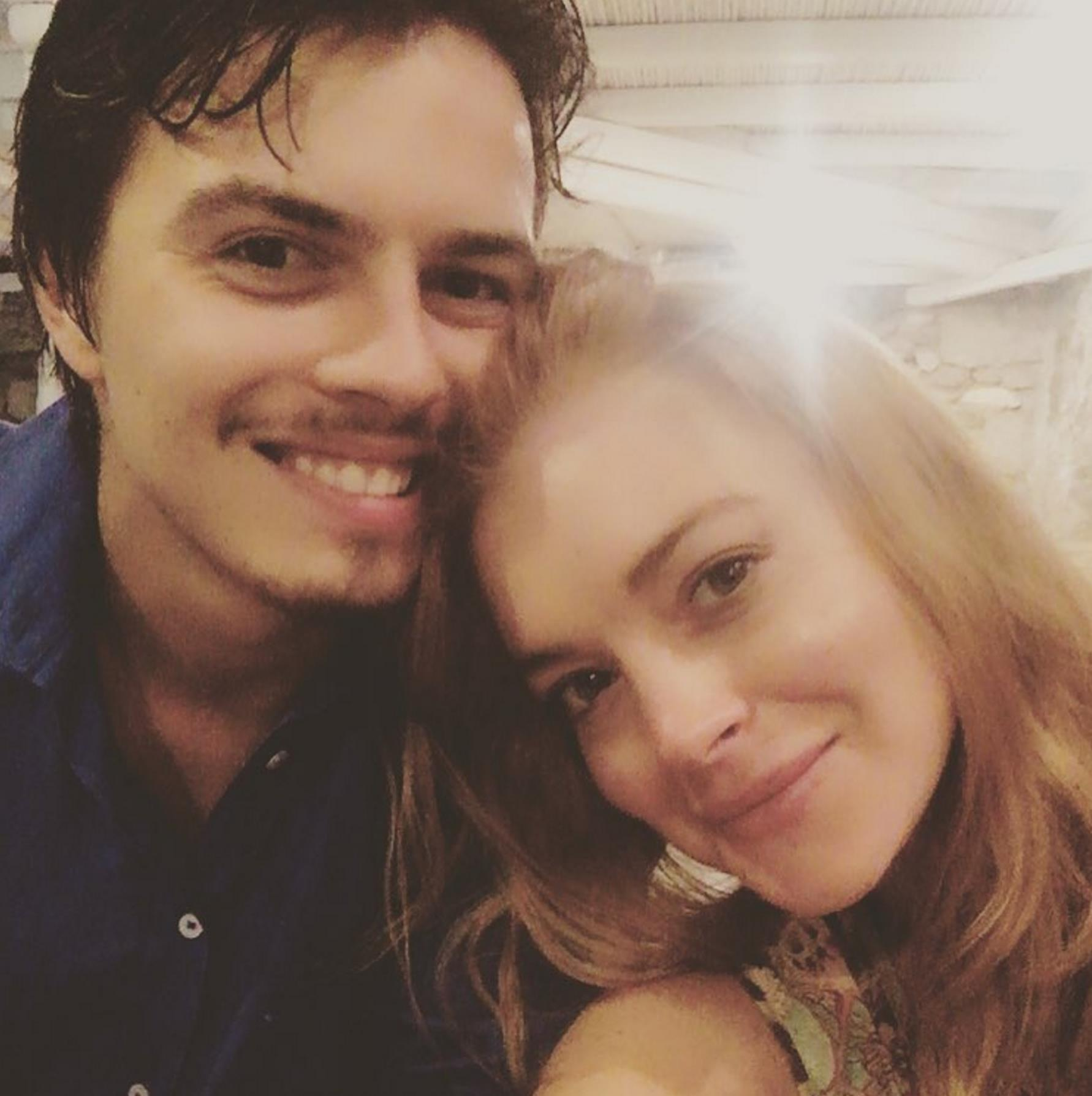 Lindsay Lohan's fiance parties with mystery woman