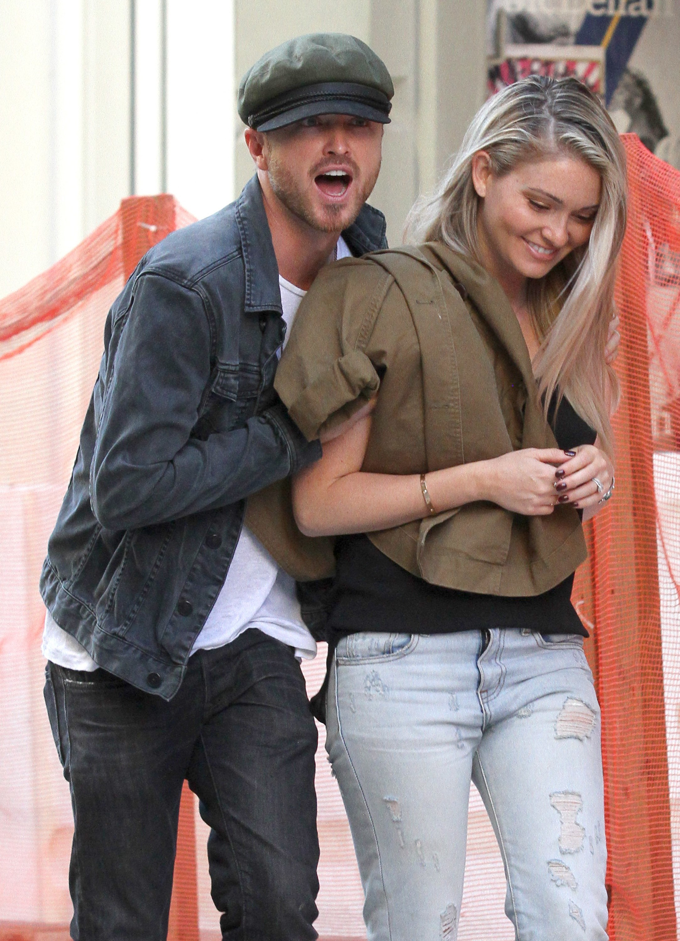 Aaron Paul squeezes his main squeeze during flirty evening stroll