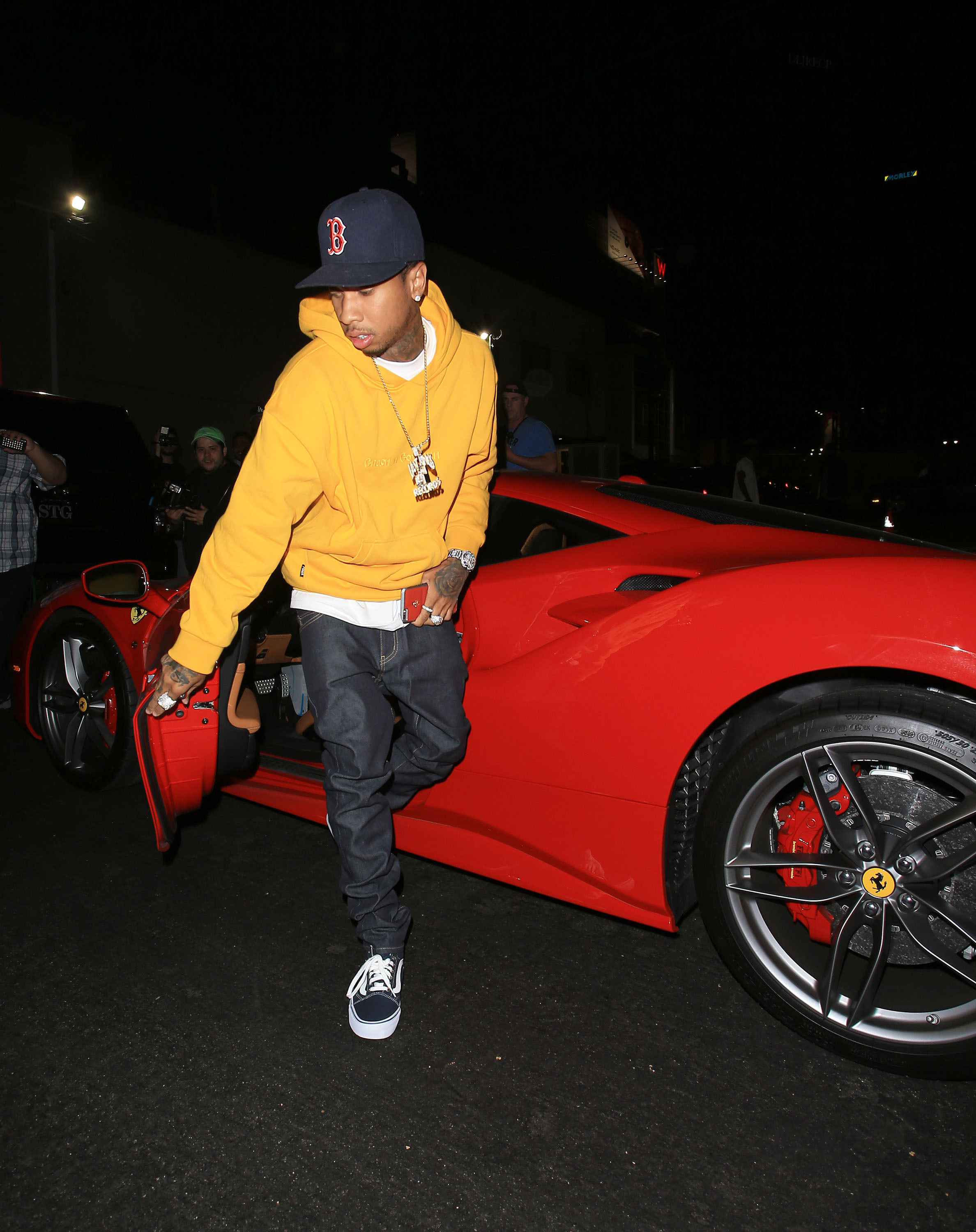 Tyga  gets out of Ferrari