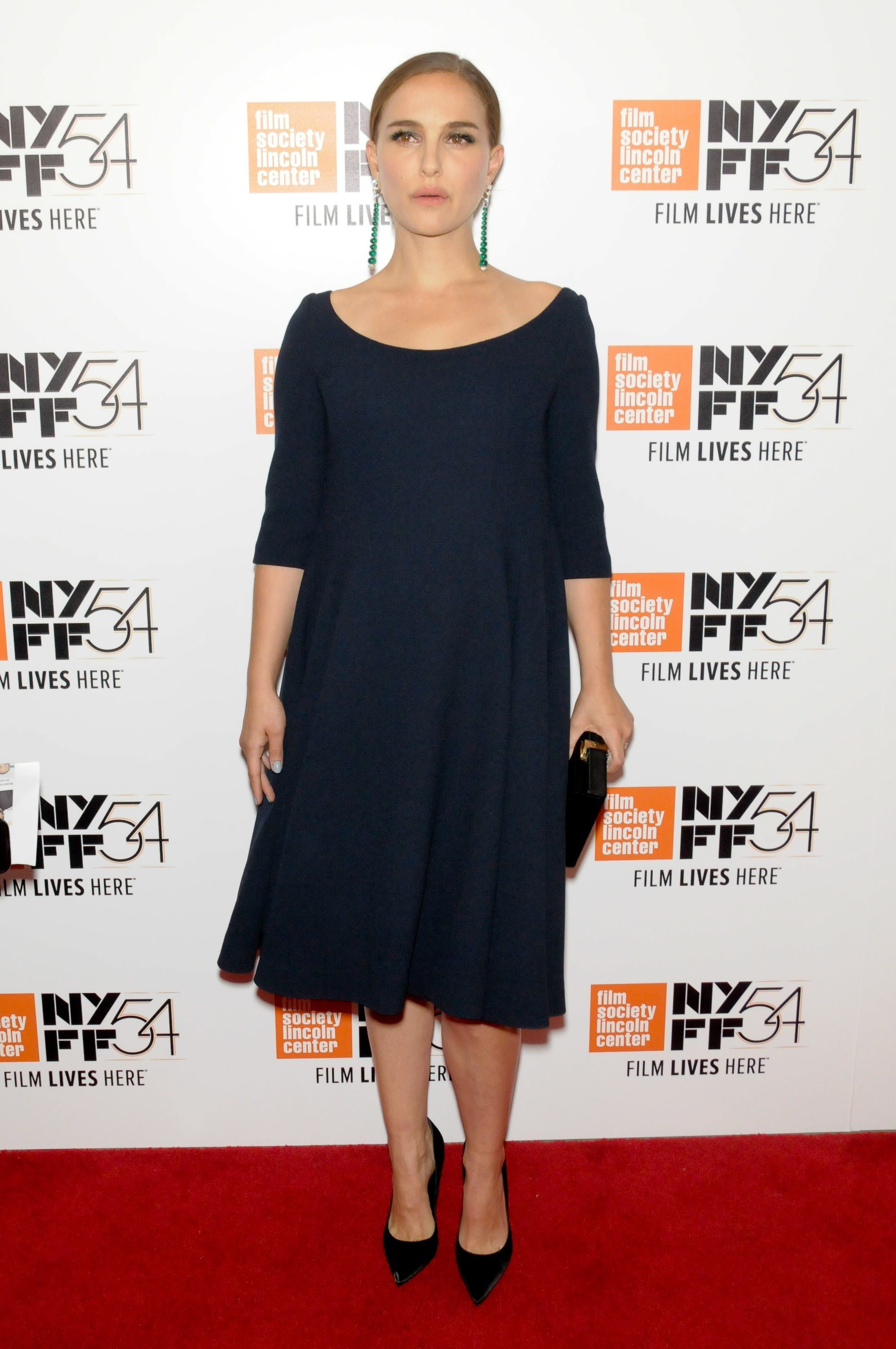 Natalie Portman shows off her growing bump at NYFF premiere