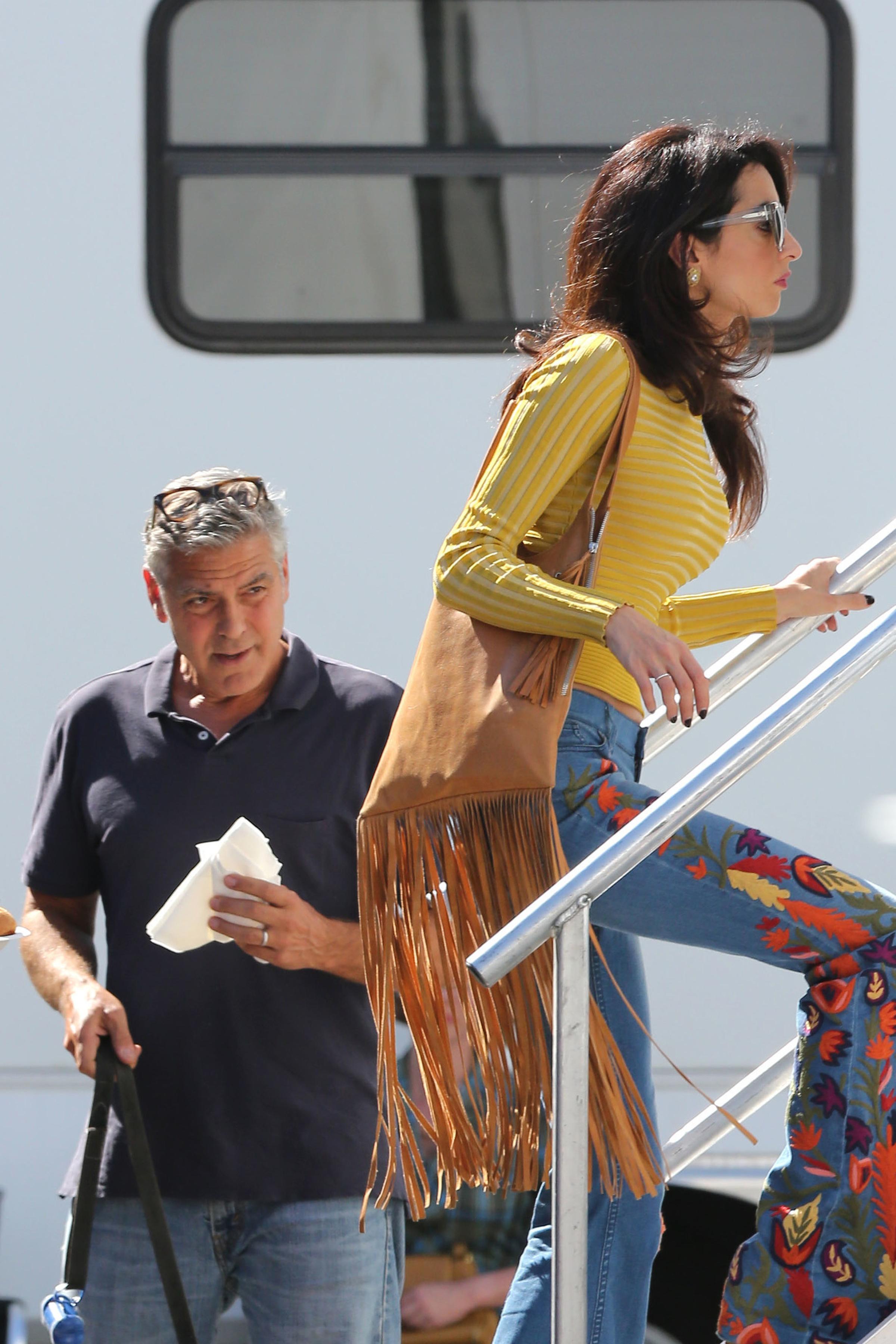 Amal Clooney visits George Clooney on set