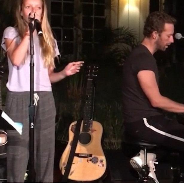 Chris Martin backs up his singing kids at charity show