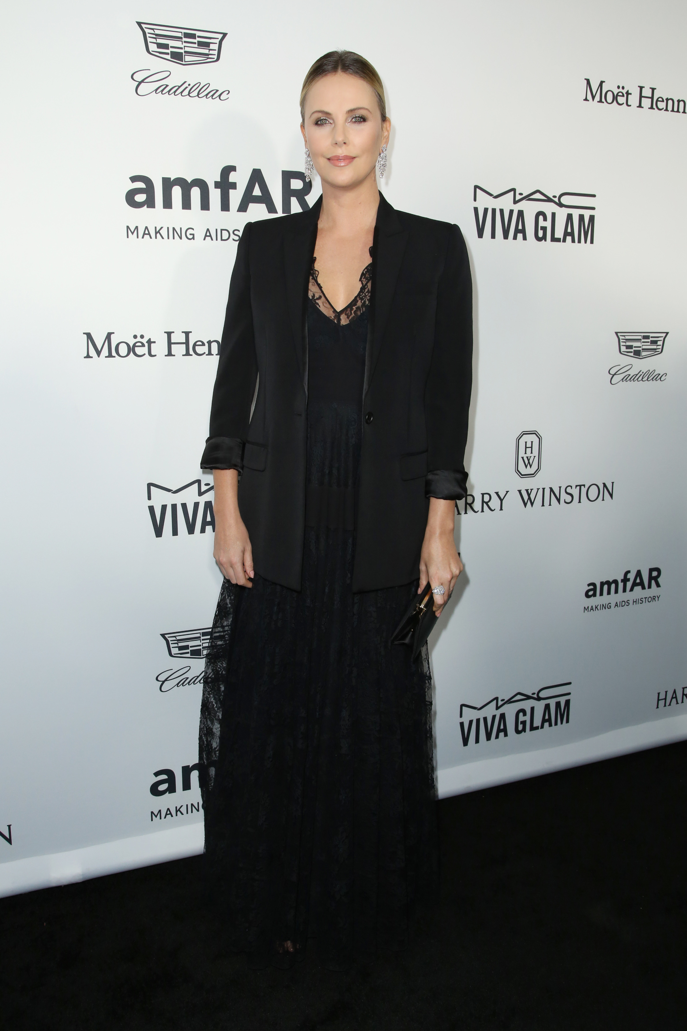 Charlize Theron jokes about her weight at amfAR Inspiration gala