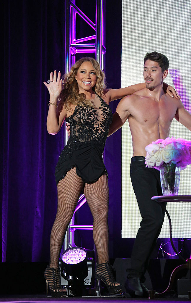 Mariah Carey and her backup dancer enjoy some seaside PDA
