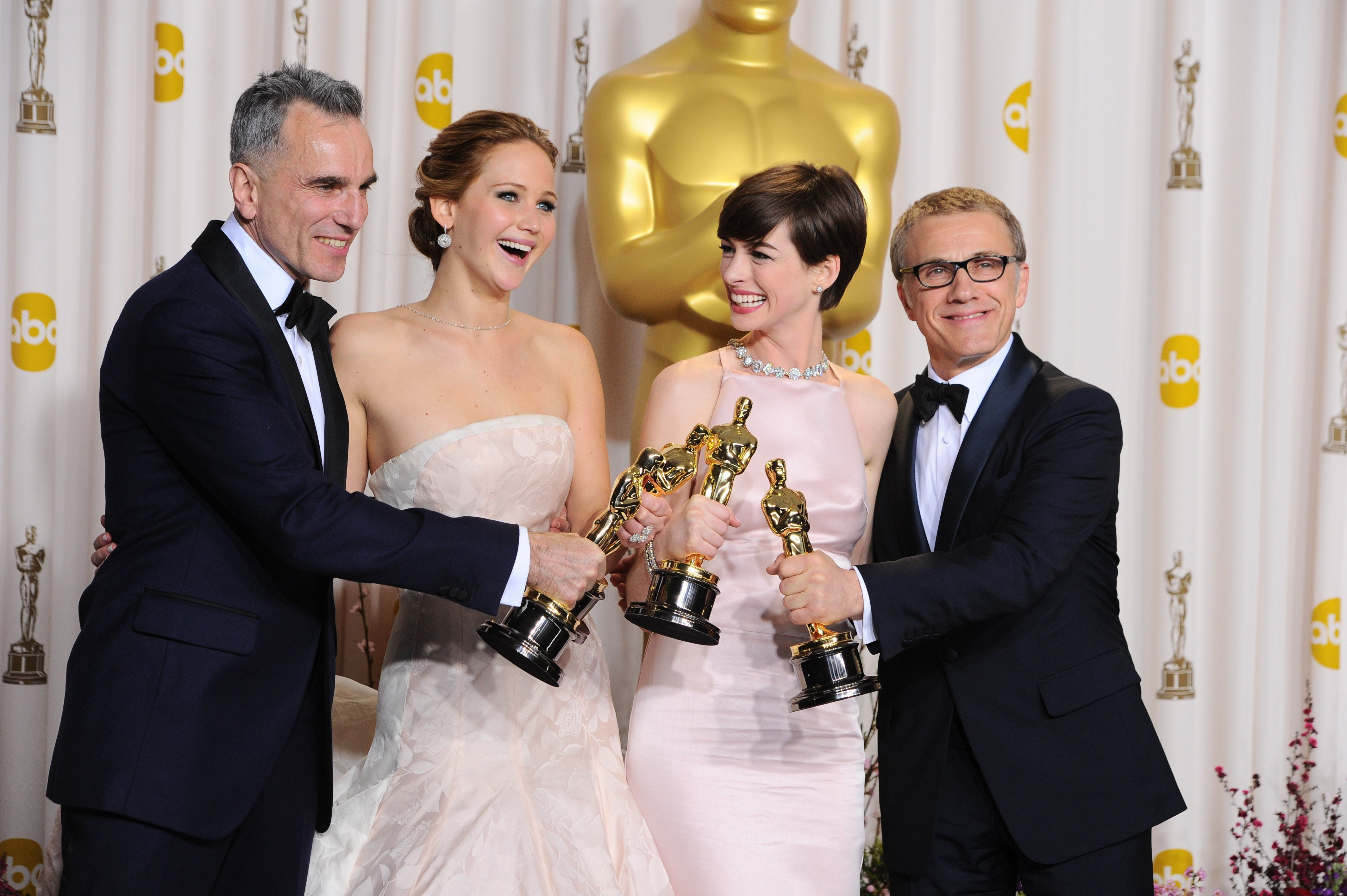 Daniel Day Lewis, Jennifer Lawrence, Anne Hathaway and Christoph Waltz pose with their Oscars during the 85th Annual Academy Awards in Hollywood on Feb. 24, 2013.