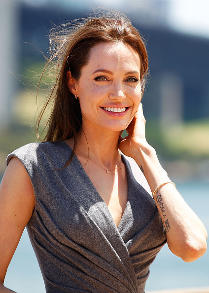 """Angelina Jolie poses at a photocall for """"Unbroken"""" at the Sydney Opera House in Australia on Nov. 18, 2014."""