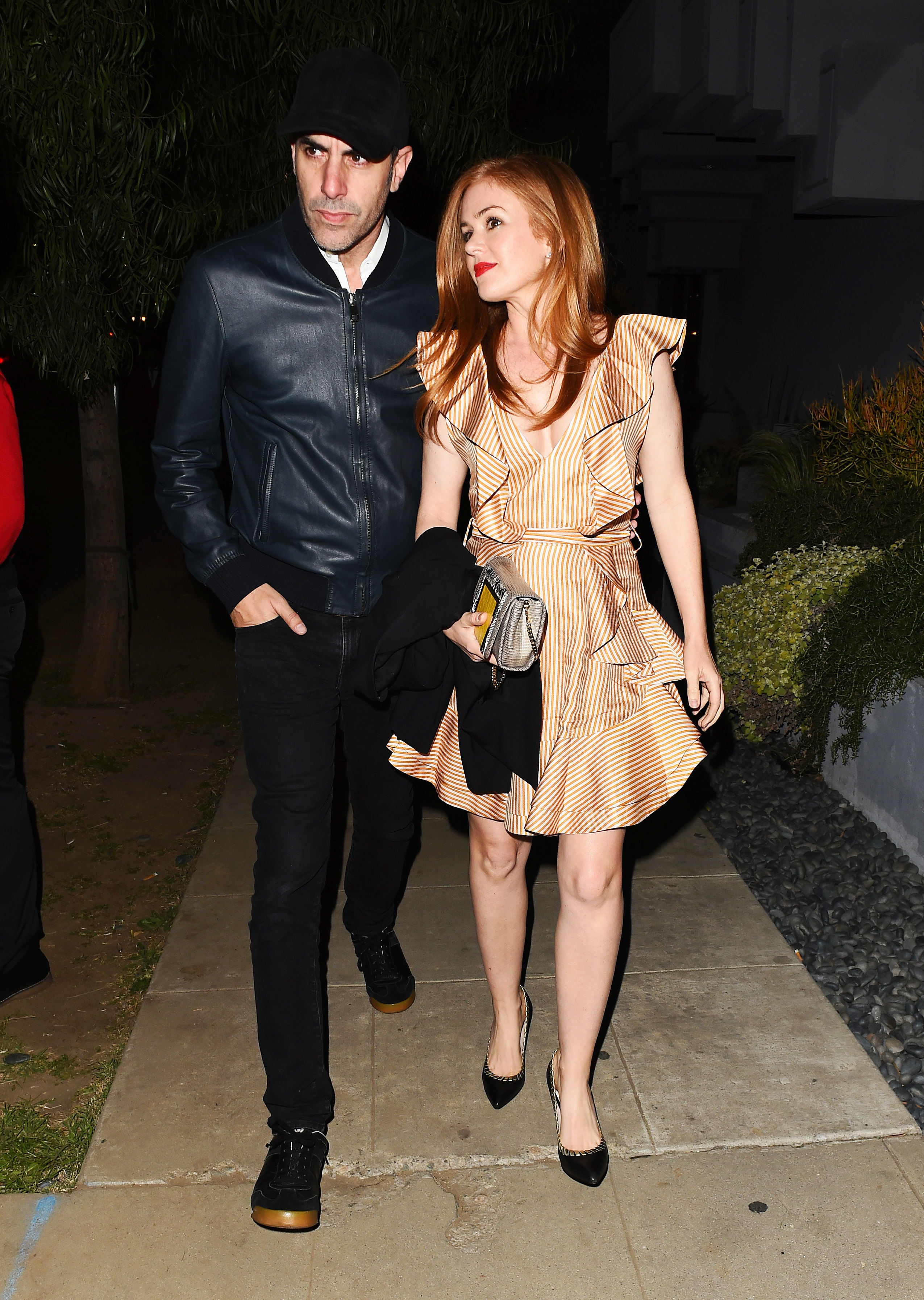 Sacha Baron Cohen and Isla Fisher arrive at Elton John's 70th birthday party at RED Studios Hollywood in Los Angeles on March 25, 2017.